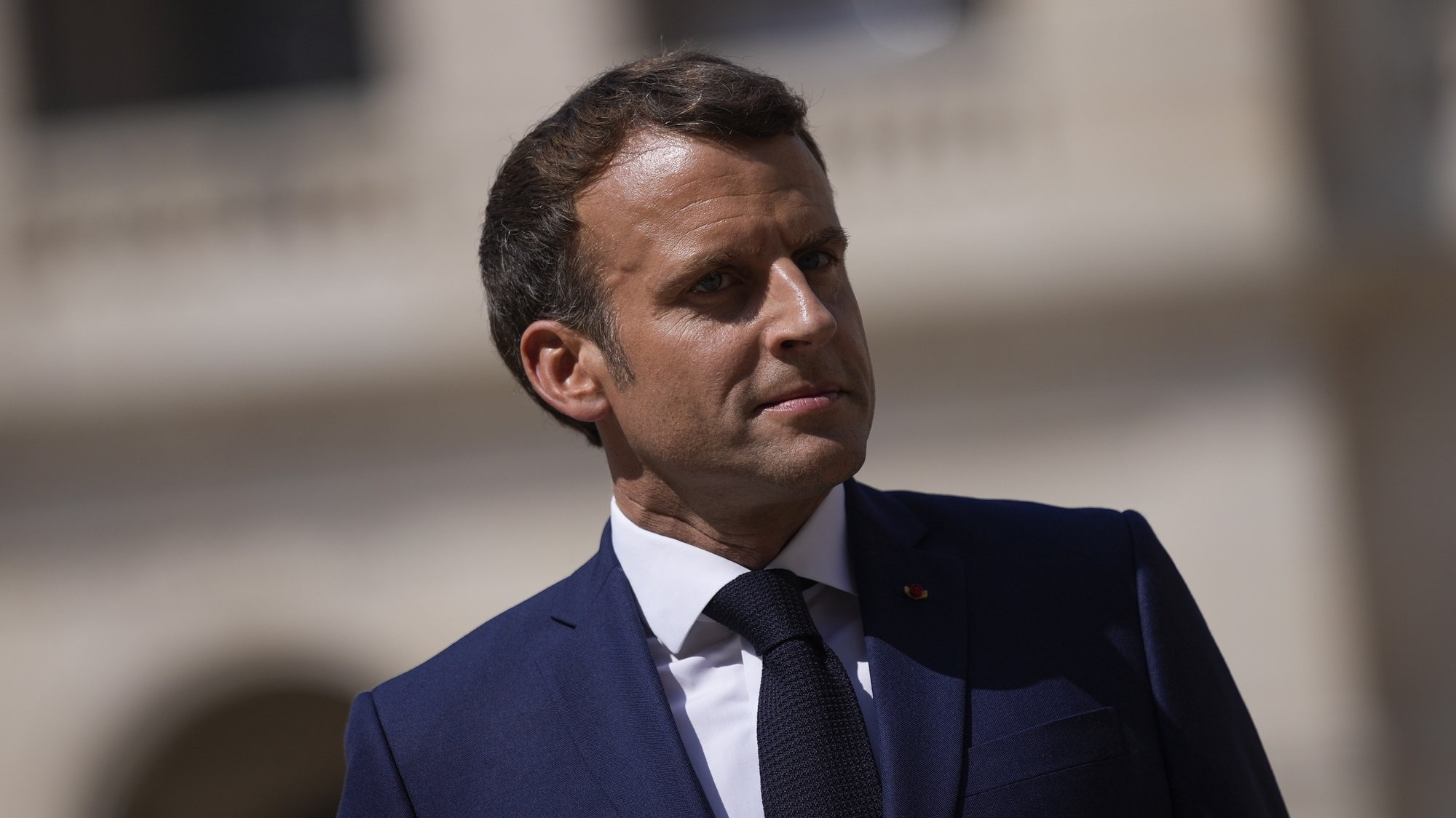 epa09356816 French President Emmanuel Macron attends a farewell ceremony for the French armed forces chief of staff, Gen. Francois Lecointre at the Invalides monument in Paris, France, 21 July 2021.  EPA/DANIEL COLE / POOL MAXPPP OUT