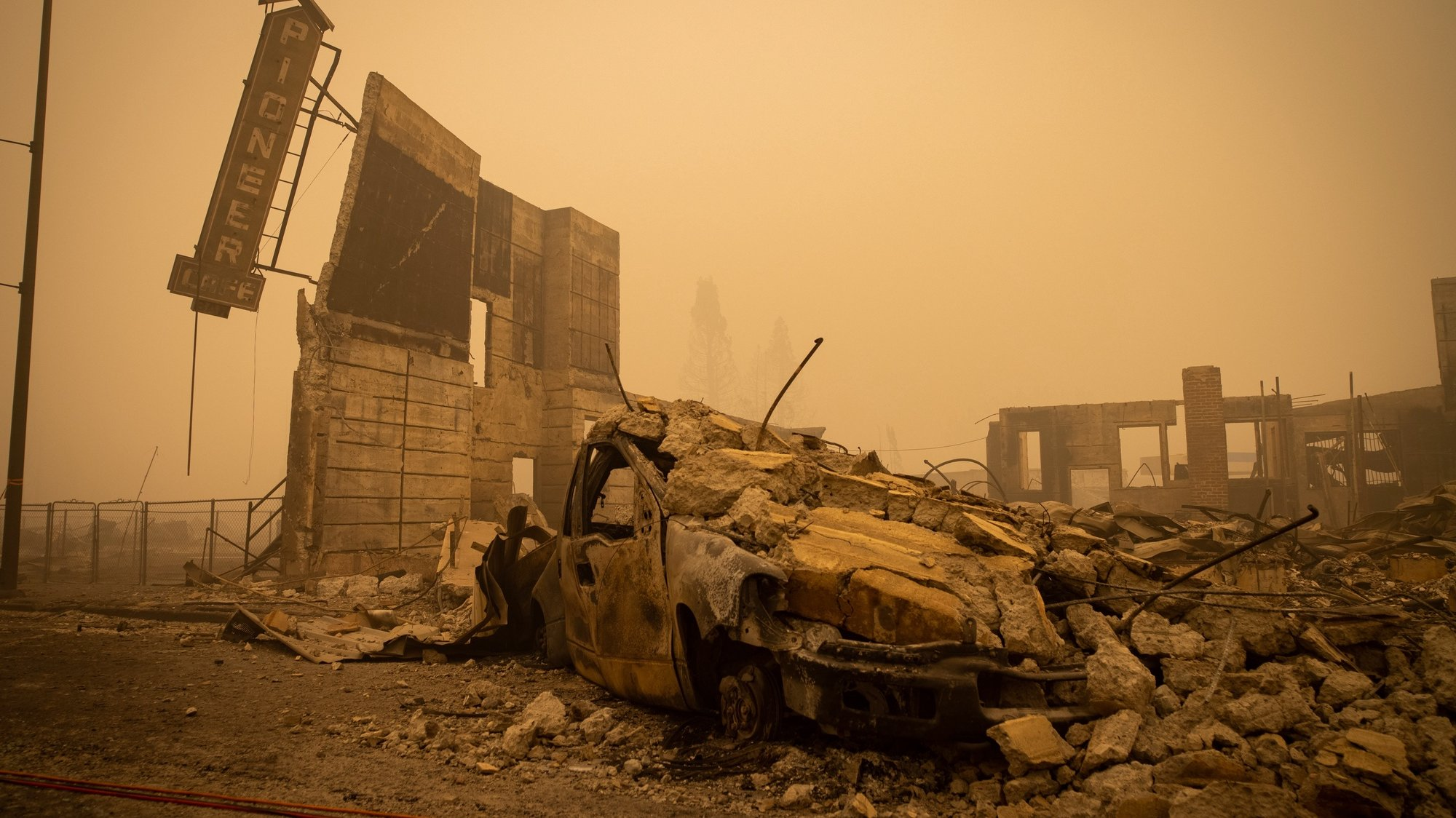 epa09404930 Buildings and vehicles are left destroyed by the Dixie Fire in Greenville, California, USA, 07 August 2021. The Dixie Fire had grown to over 440,000 acres as of 07 August.  EPA/CHRISTIAN MONTERROSA
