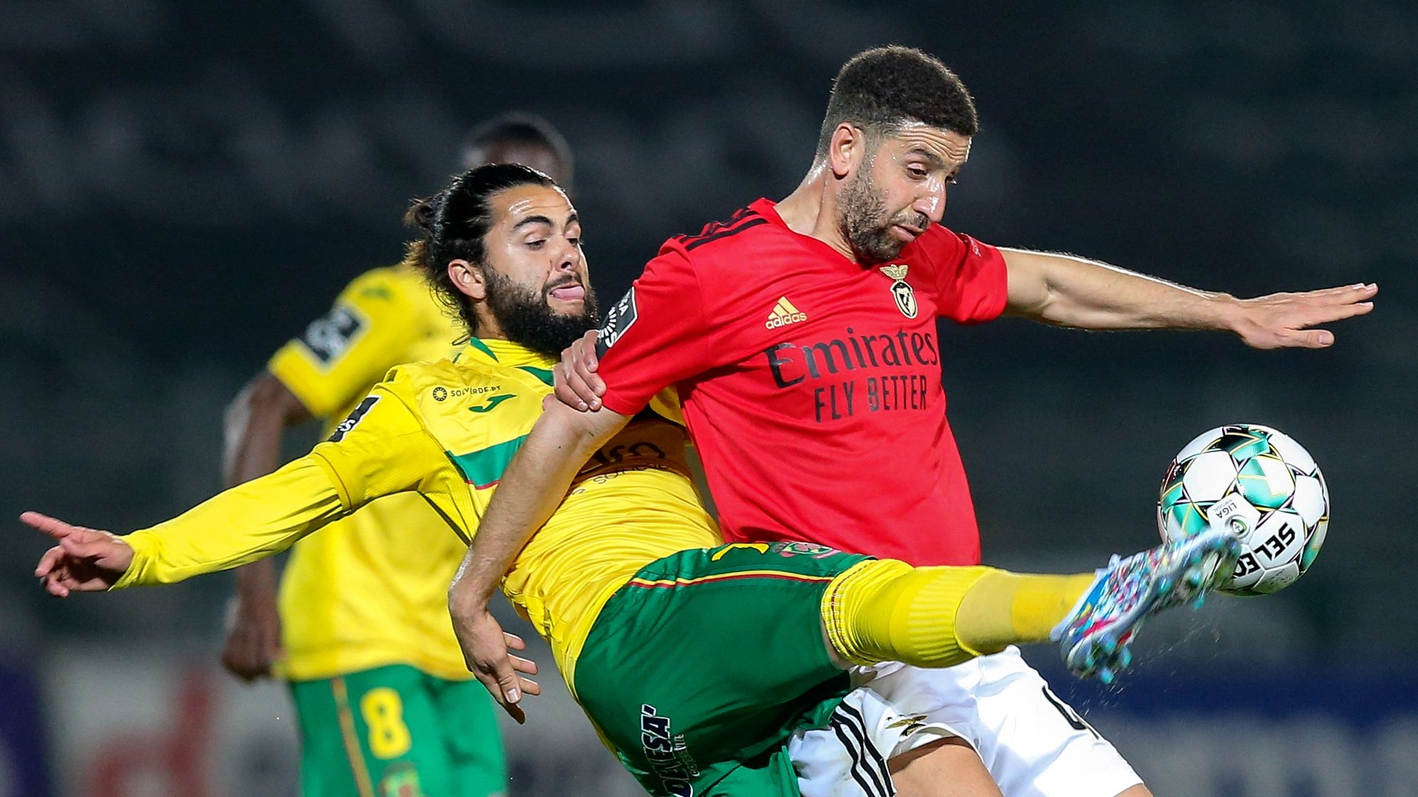 Pacos de Ferreira's Joao Amaral (L) in action against Benfica's Adel Taarabt during their Portuguese First League soccer match held in Pacos de Ferreira, Portugal, 10 April 2021. JOSE COELHO/LUSA