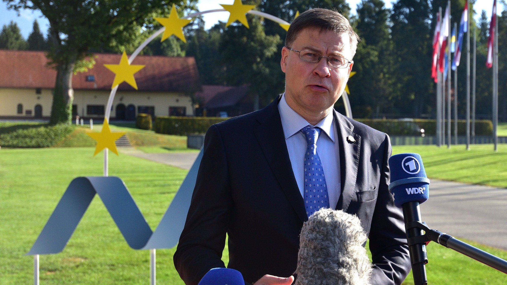 epa09459057 European Commission Executive Vice President Valdis Dombrovskis speaks before an Informal meeting of EU Ministers for Economic and Financial Affairs, at the Kongresni center Brdo, Predoslje, Slovenia, 10 September 2021. Slovenia is hosting a two-day Informal Meeting of EU Ministers for Economic and Financial Affairs.  EPA/IGOR KUPLJENIK
