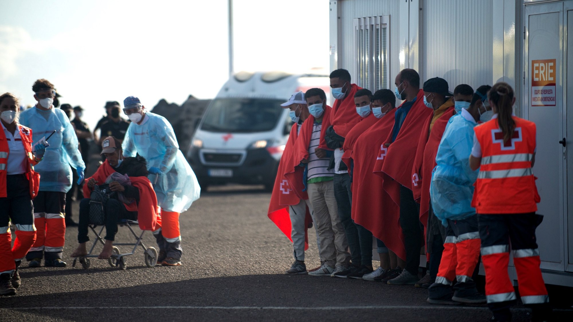 epa09468304 Migrants arrive at the port of Arrecife in Lanzarote, Canary islands, Spain, 14 September 2021. Some 200 migrants were rescued by Spanish Salvamento Maritimo's rescue vessel 'Salvamar Al Nair' as they sailed aboard six dugouts. A total of 400 migrants were rescued in the Canary islands within the last hours.  EPA/Javier Fuentes Figueroa