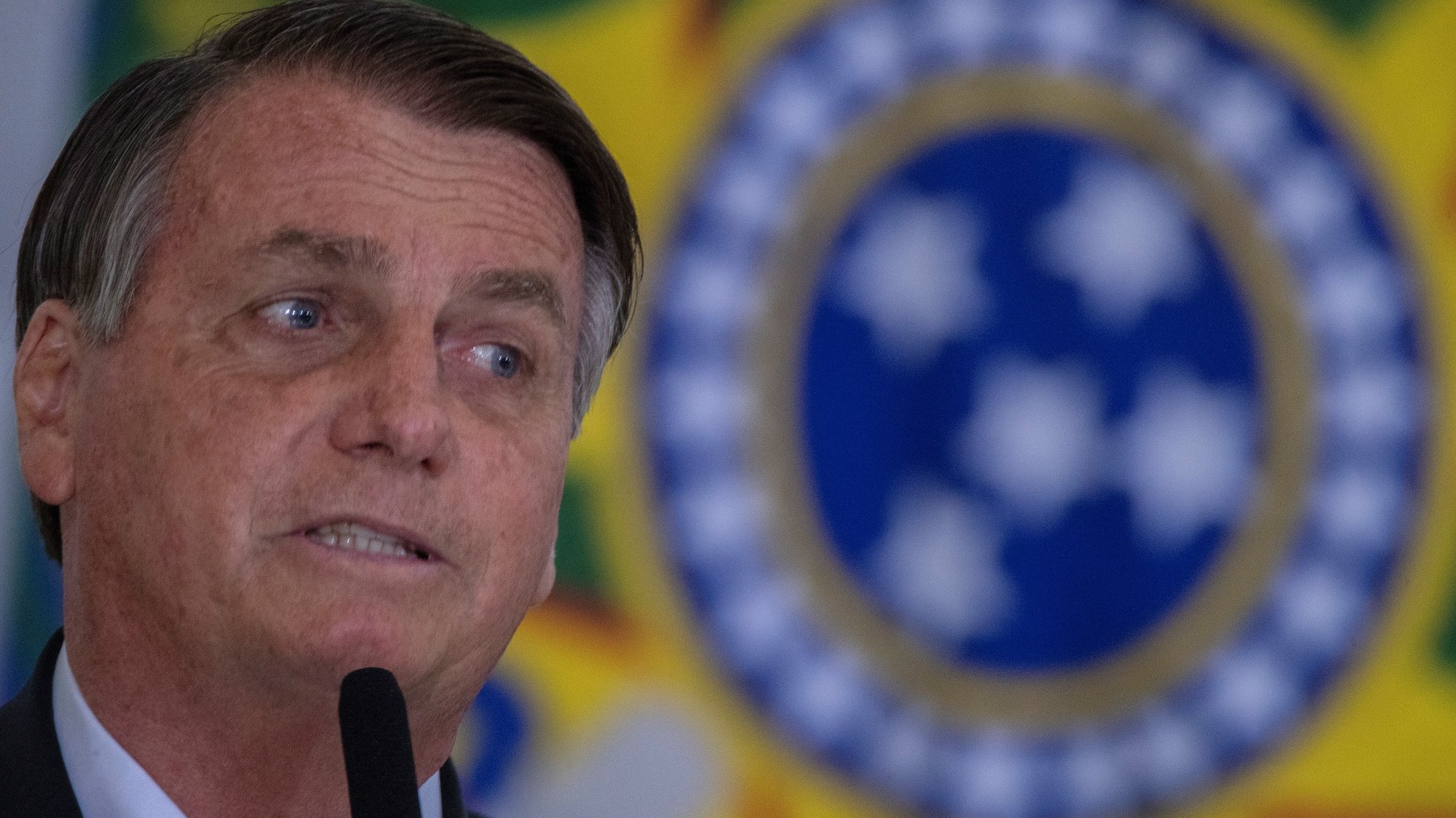 epa09469929 The President of Brazil, Jair Bolsonaro, participates in the Call for Progress in the 'Casa Verde e Amarela' Program, at the Palacio do Planalto, in the city of Brasilia, Brazil, 15 September 2021. Bolsonaro reiterated this 15 September that the 'ancestral right' that the indigenous people claim over the lands could lead to 'losing a Germany and a Spain together' and cause 'a catastrophe' to the country's agriculture. The president insisted on the matter on the eve of the Supreme Court continuing a trial in which it must rule in relation to the so-called 'time frame', which only recognizes as indigenous land that which the native peoples occupied on 05 October 1988, when the current Brazilian Constitution was promulgated.  EPA/Joedson Alves