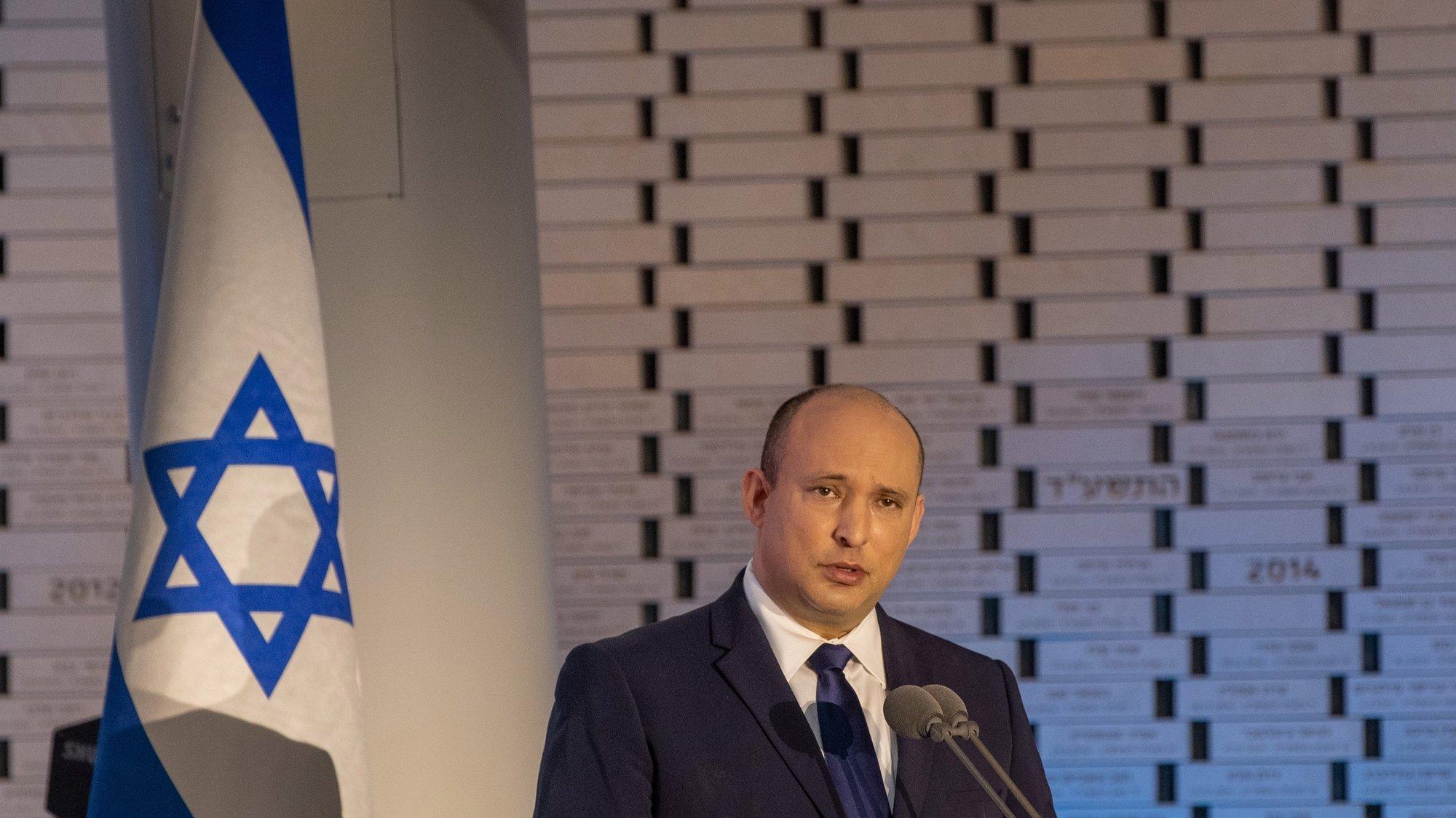 epa09476104 Israeli Prime Minister Naftali Bennett attends the 48th memorial ceremony for the fallen of the Yom Kippur War, also known as the Ramadan War or October War, at Mt. Herzl in Jerusalem, 19 September 2021.  EPA/Ohad Zwigenberg / POOL