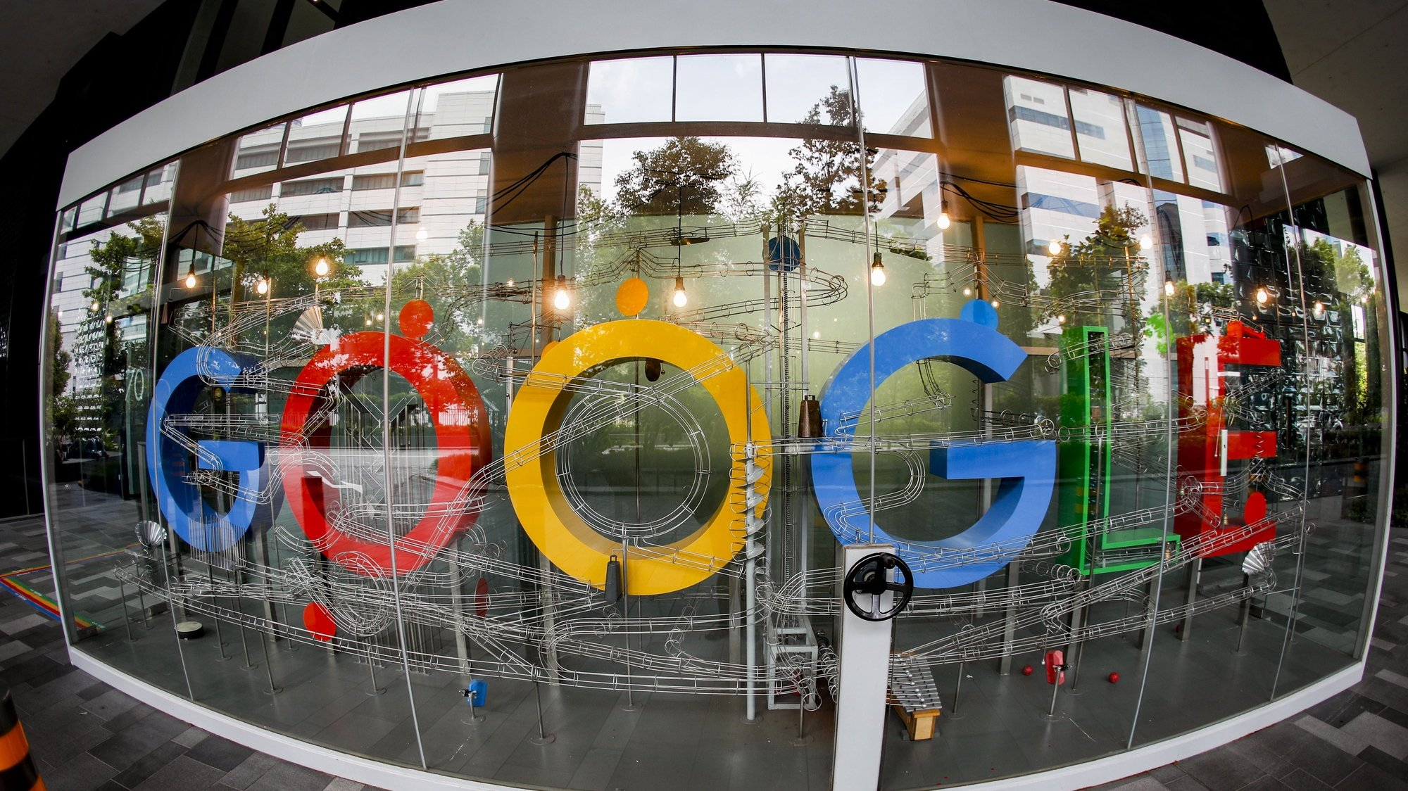 epa08873751 (FILE) A  picture made with a fisheye lens shows the Google logo in Singapore, 06 December 2019 (reissued 10 December 2020). According to media reports on 10 December 2020, French data privacy regulator CNIL will impose over 100 million euros fines on US companies Google and Amazon for breaching EU privacy data rules. According to media reports, Google will have to pay 100 million euros and Amazon 35 million euros fines.  EPA/WALLACE WOON *** Local Caption *** 55685412