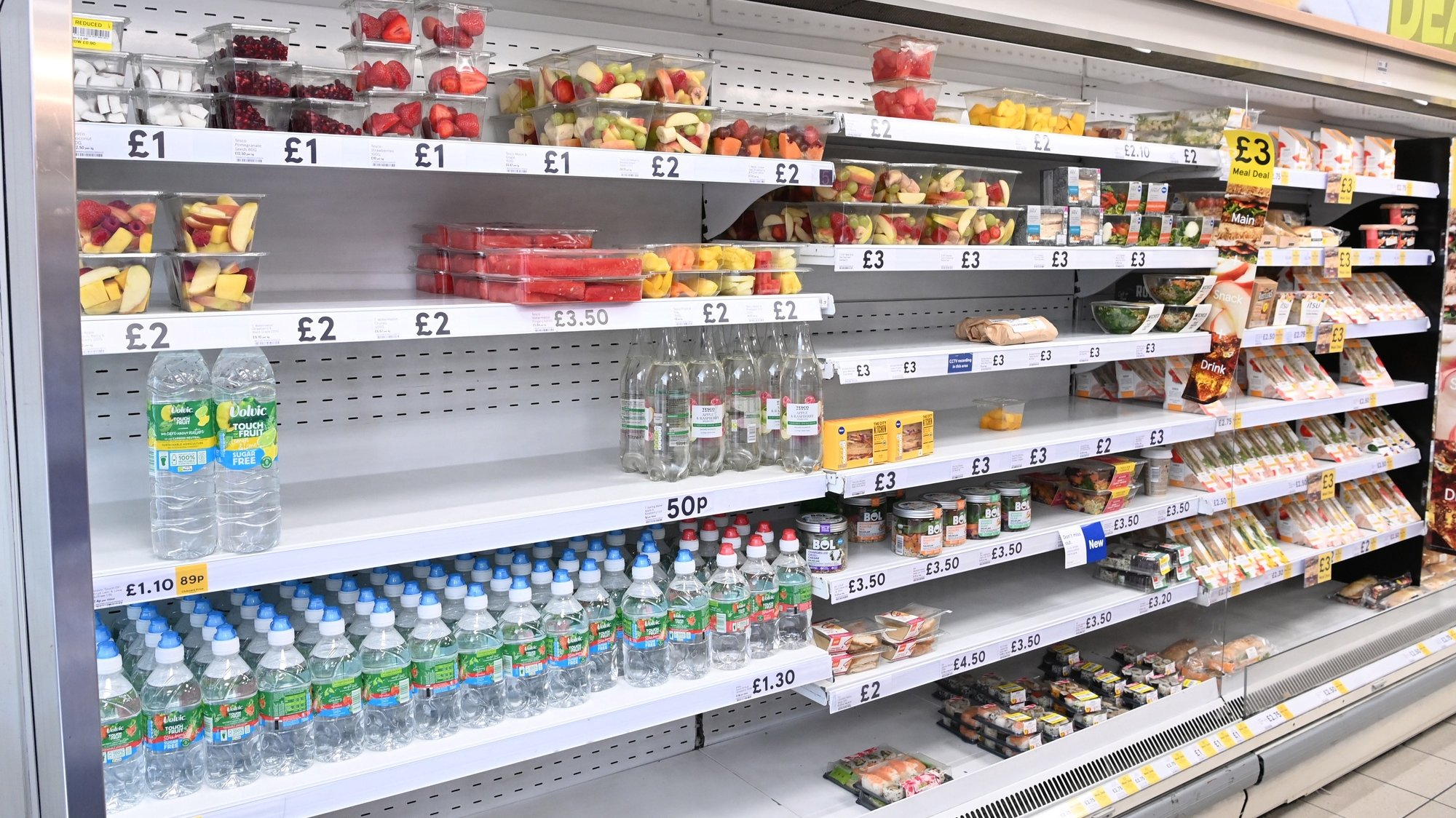 epa09358553 Food yet to be shelved at a supermarket in London, Britain, 22 July 2021. British supermarkets are struggling to stock shelves as staff shortages take their toll due to the so called 'pingdemic'. With so many staff going into self isolation after being pinged by the NHS app, supermarkets are now under increasing pressure to keep shelves fully stocked. The British government is being urged to allow supermarket staff to be exempt from self-isolation rules.  EPA/FACUNDO ARRIZABALAGA