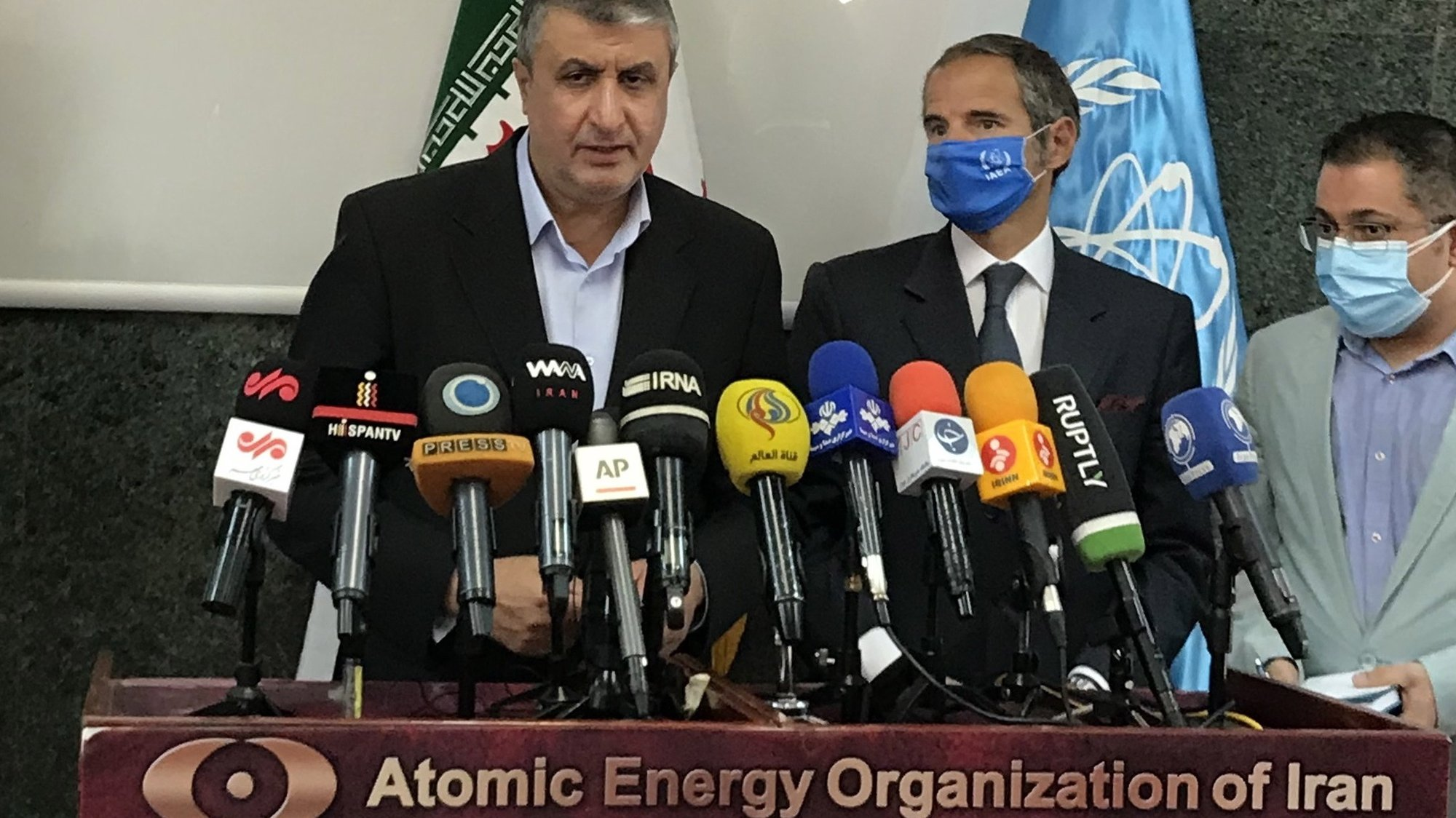 epa09463127 A handout picture made available by the Iran Atomic Organization official website (aeoi) shows, Iranian Atomic Organization chief Mohammad Eslami (L)and Rafael Mariano Grossi (C), Director General of the International Atomic Energy Agency (IAEA) during a joint press conference in Tehran, Iran, 12 September 2021. Grossi is in Tehran to meet with Iranian officials.  EPA/AEOI HANDOUT  HANDOUT EDITORIAL USE ONLY/NO SALES