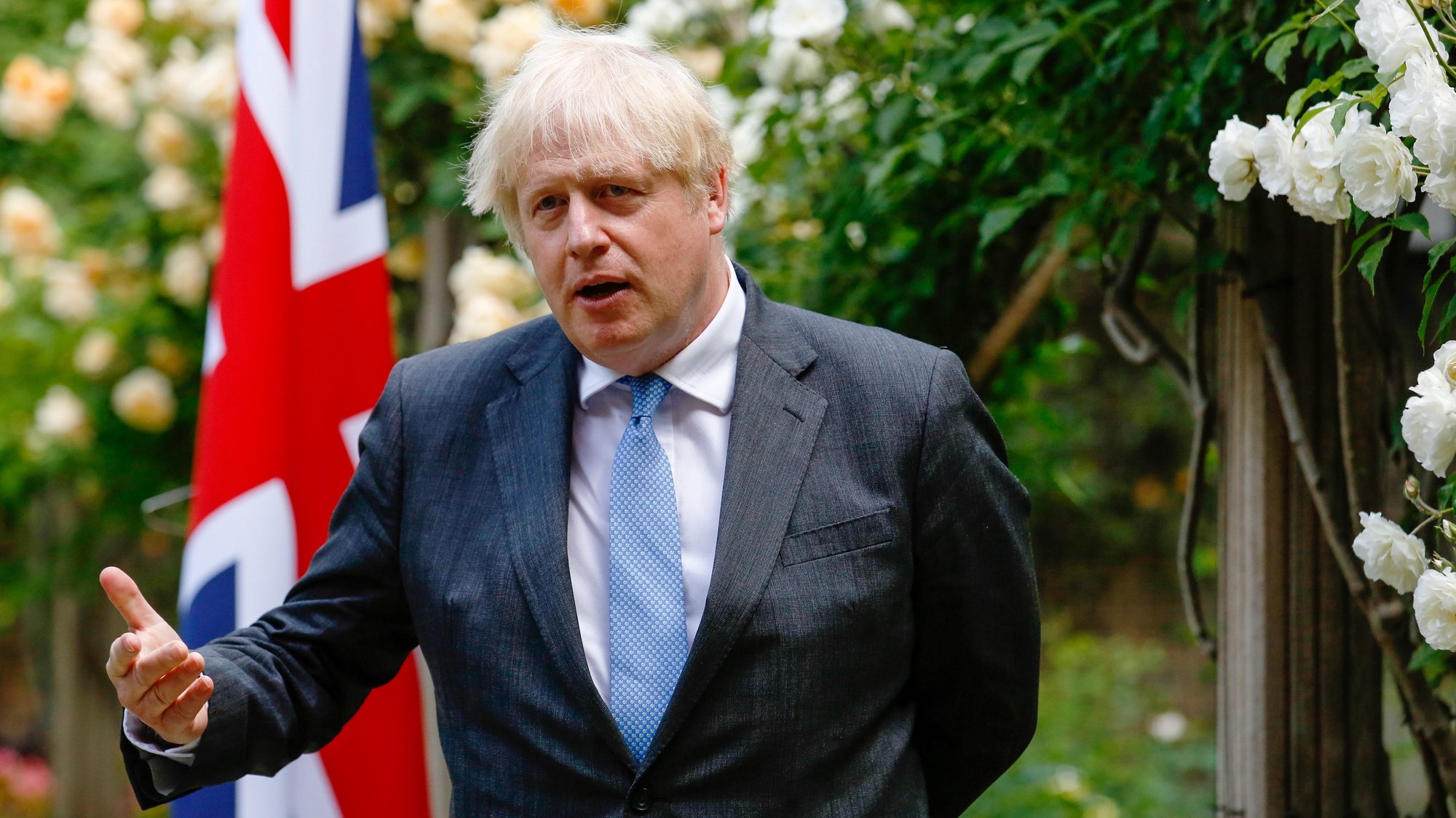 epa09272673 British Prime Minister Boris Johnson, gestures during a joint news conference with Australian counterpart Scott Morrison, during their bilateral meeting in the garden of number 10 Downing Street in London, Britain, 15 June 2021. The U.K. is set to announce the broad terms of a free-trade deal with Australia on 15 June, its latest post-Brexit accord as Prime Minister Boris Johnson seeks to expand commerce beyond the European Union.  EPA/Luke MacGregor / POOL