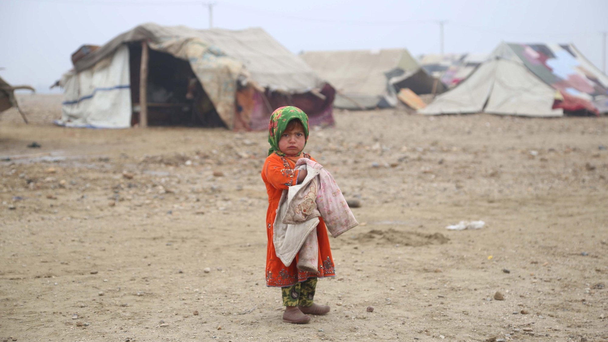 epaselect epa08843696 A child, who fled with its family after Taliban launched massive attacks in different districts of Helmand province, live in temporary shelters in Sarhrood district of Nangarhar province, Afghanistan, 26 November 2020. At least 26,025 Afghan children have been killed or permanently disabled in the Afghan conflict over the past 14 years, since 2005, nonprofit Save the Children said in a report published on 23 November.  EPA/GHULAMULLAH HABIBI