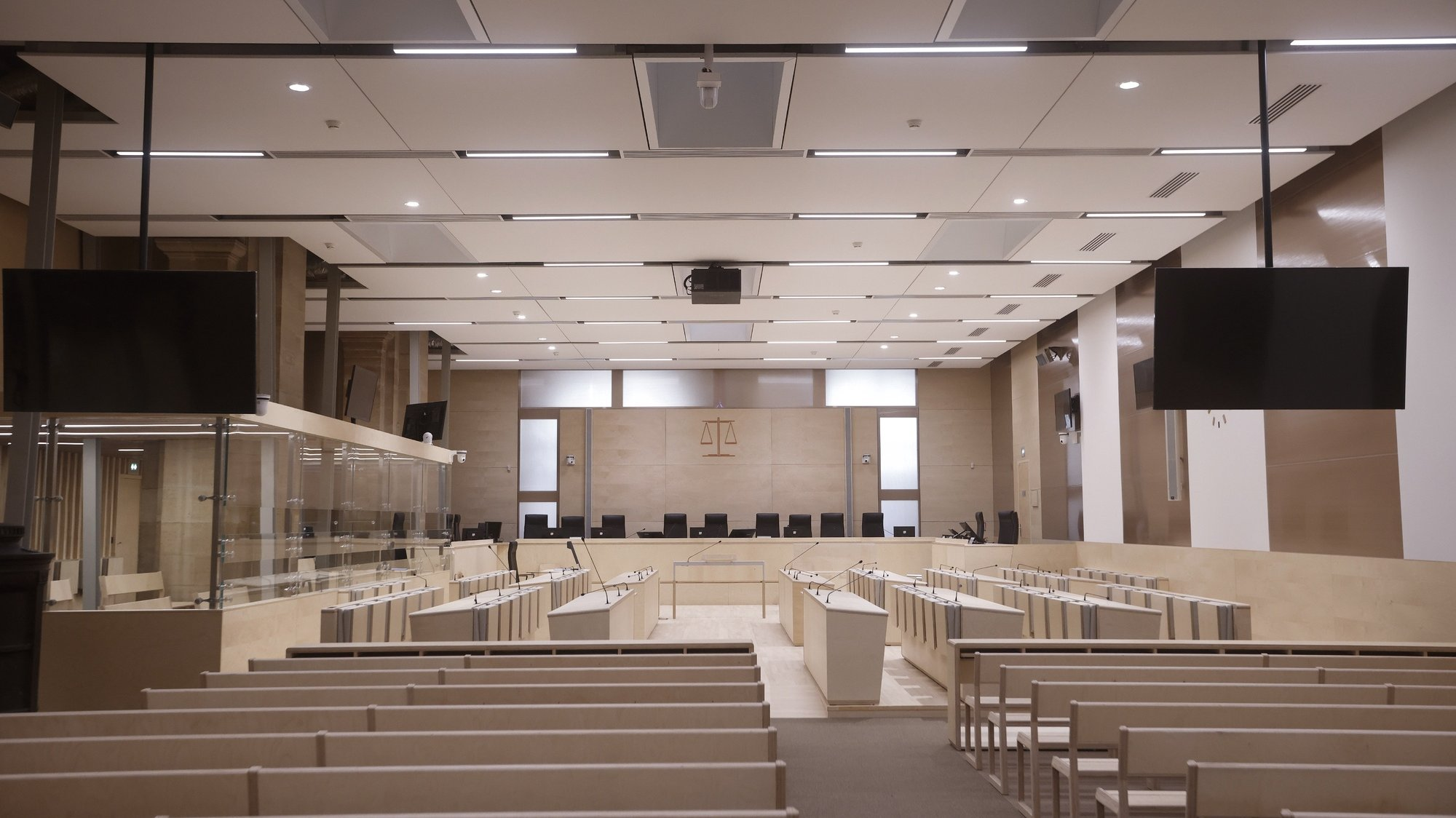 epa09442661 An interior view of the temporary courtroom prepared for trial over 2015 terrorist attacks at the courthouse in Paris, France, 02 September 2021. The trial over the 13 November 2015 terrorist attacks is due to start on 08 September 2021 and will last nine months. The attacks killed 130 people with hundreds injured which targeted the Bataclan concert hall, the Stade de France national sports stadium, and several restaurants and bars.  EPA/YOAN VALAT