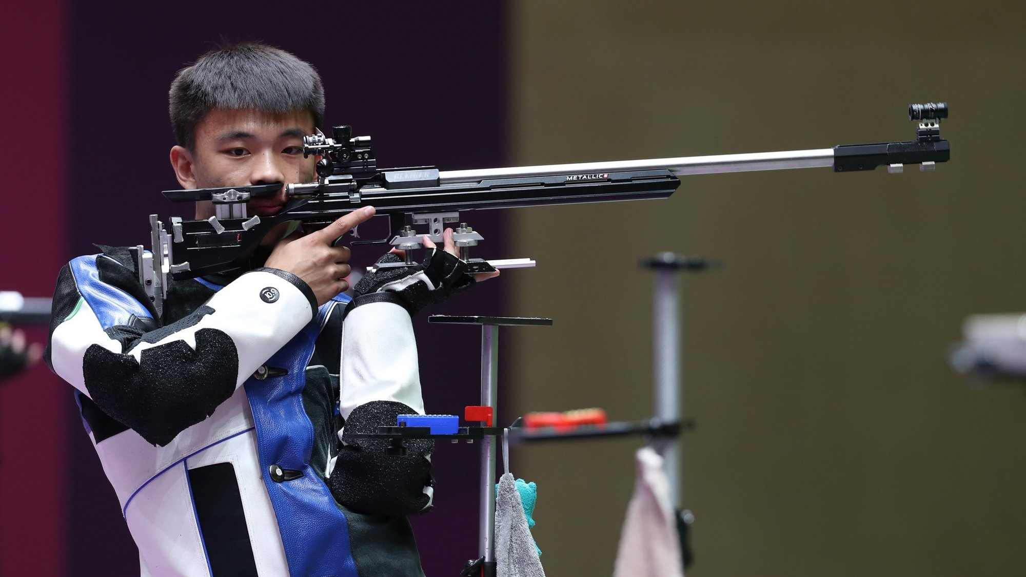 epa09387497 Changhong Zhang of China competes during the 50m Rifle 3 Positions Men's final Victory Ceremony at the Shooting events of the Tokyo 2020 Olympic Games at the Camp Asaka in Nerima, Tokyo, Japan, 02 August 2021.  EPA/HEDAYATULLAH AMID