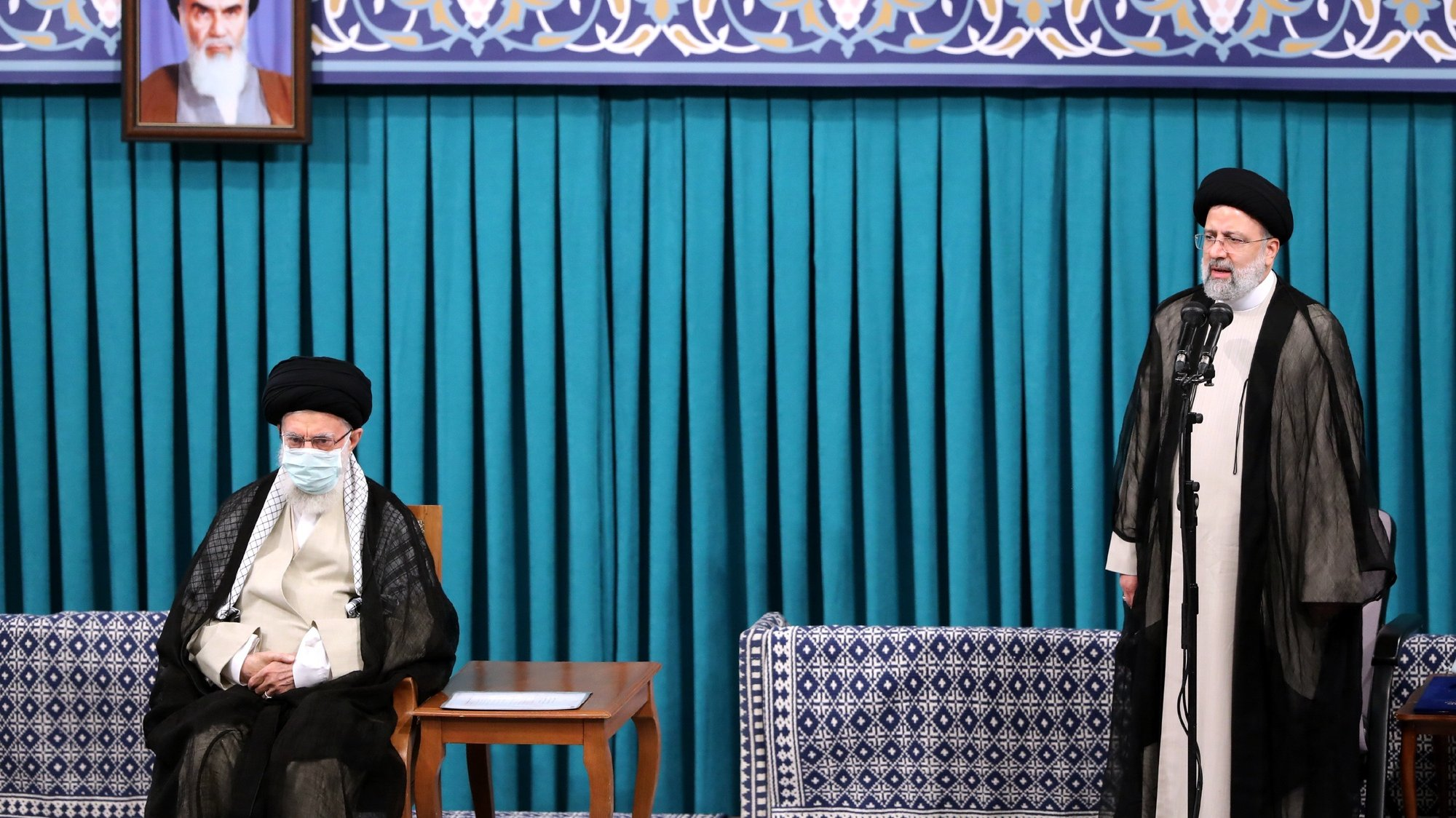 epa09389953 A handout picture made available by Iran's Supreme Leader Office shows Iranian supreme leader Ayatollah Ali khamenei (L) listens to new Iranian president Ebrahim Raisi (R), in Tehran, Iran, 03 August 2021. Iranian presidents are first approved by the supreme leader, who according to constitution is the actual head of state, and then take the oath before parliament. Ebrahim Raisi has been inaugurated as the new president of the Islamic Republic of Iran on 03 August 2021, as the country is facing an economic crisis along with the coronavirus disease (COVID-19) pandemic.  EPA/IRAN'S SUPREME LEADER OFFICE HANDOUT  HANDOUT EDITORIAL USE ONLY/NO SALES