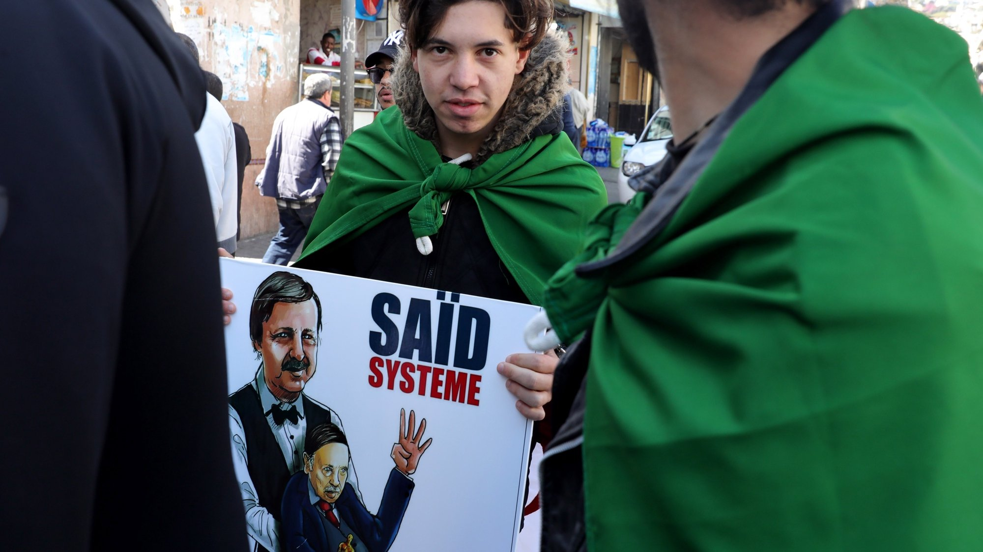 epa07515714 (17/20) Algerian youngsters from SOS Bab El Oued to join a protest against the then President Abdelaziz Bouteflika in Algiers, Algeria, 29 March 2019. Placard depicts former President Abdelaziz Bouteflika being moved like a puppet by his advisor and brother Said Bouteflika. In February 2019 and all Fridays since, Algerians have been coming out to protest. At first, they were asking Bouteflika to renounce his candidacy for a fifth term, but it grew into demanding a change in the whole regime and a new Constitution that would allow fresh figures to emerge who could fix an economy that has led to 30 percent youth unemployment. Young men with no regular employment spend their time hanging around the streets of Algiers, doing small jobs for pocket money. They all have demands to fulfill, so they joined the rallies. Algeria's youth did not experience the War of Independence, the 1988 revolt nor the civil war. But they saw the fears their parents harbored over an uncertain future; few job prospects and a surge in emigration in search of a better future.  EPA/AMEL PAIN  ATTENTION: For the full PHOTO ESSAY text please see Advisory Notice epa07515696  and epa07515697