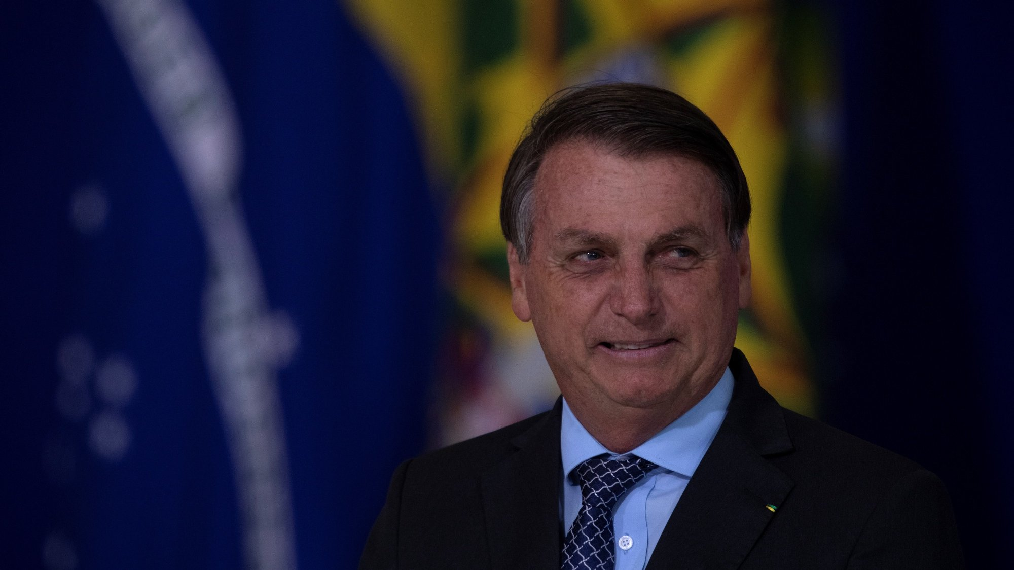 epa08810541 President of Brazil Jair Bolsonaro participates in the launch of the Alliance for Volunteering and the Friends of the Country Award, in Brasilia, Brazil, 09 November 2020.  EPA/Joedson Alves