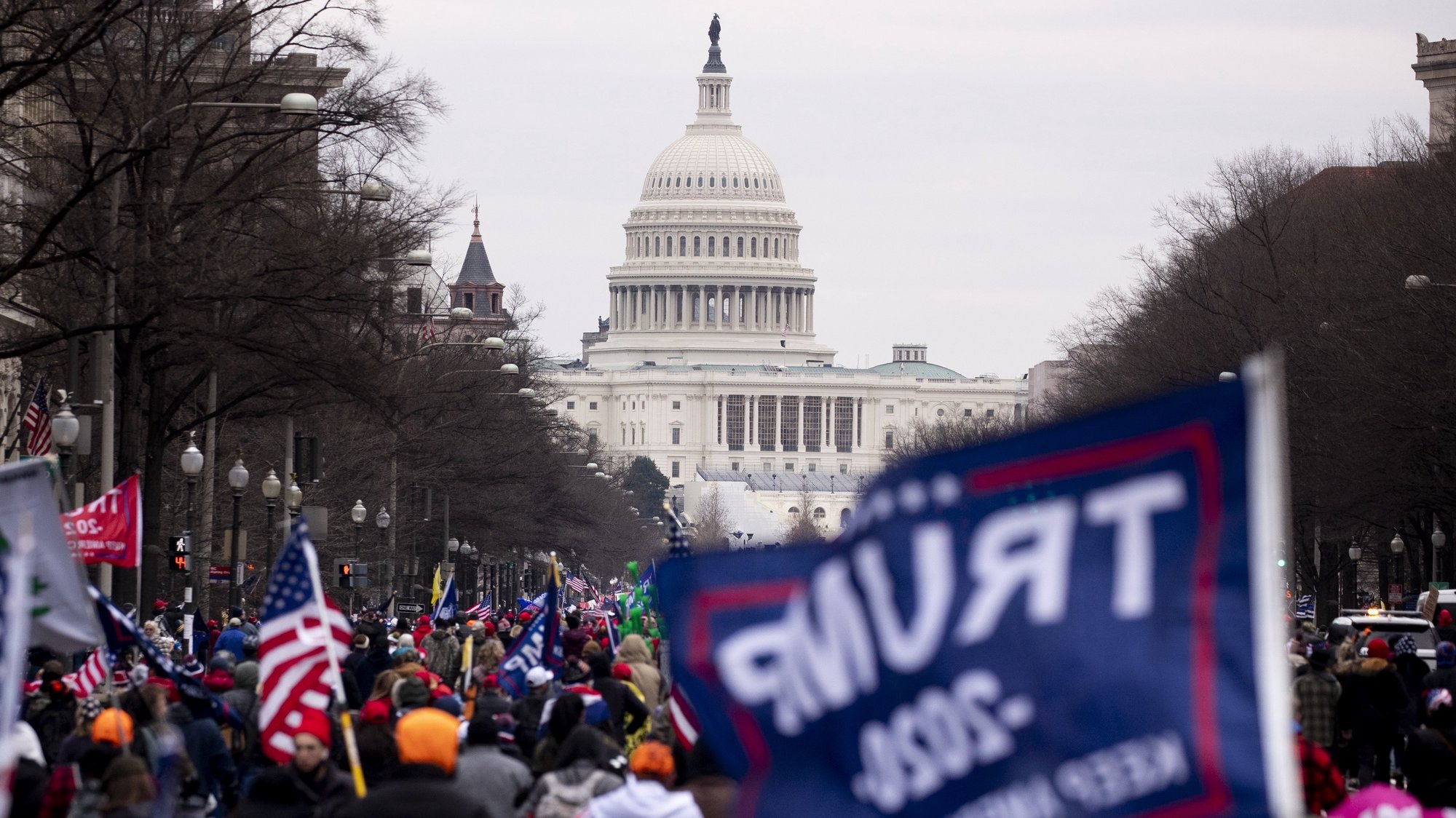 epa08923287 Pro-Trump protesters march down Pennsylvania Avenue to the US Capitol (seen behind) in Washington, DC, USA, 06 January 2021. Right-wing conservative groups are protesting against Congress counting the electoral college votes. Dozens of state and federal judges have shot down challenges to the 2020 presidential election, finding the accusations of fraud to be without merit.  EPA/MICHAEL REYNOLDS