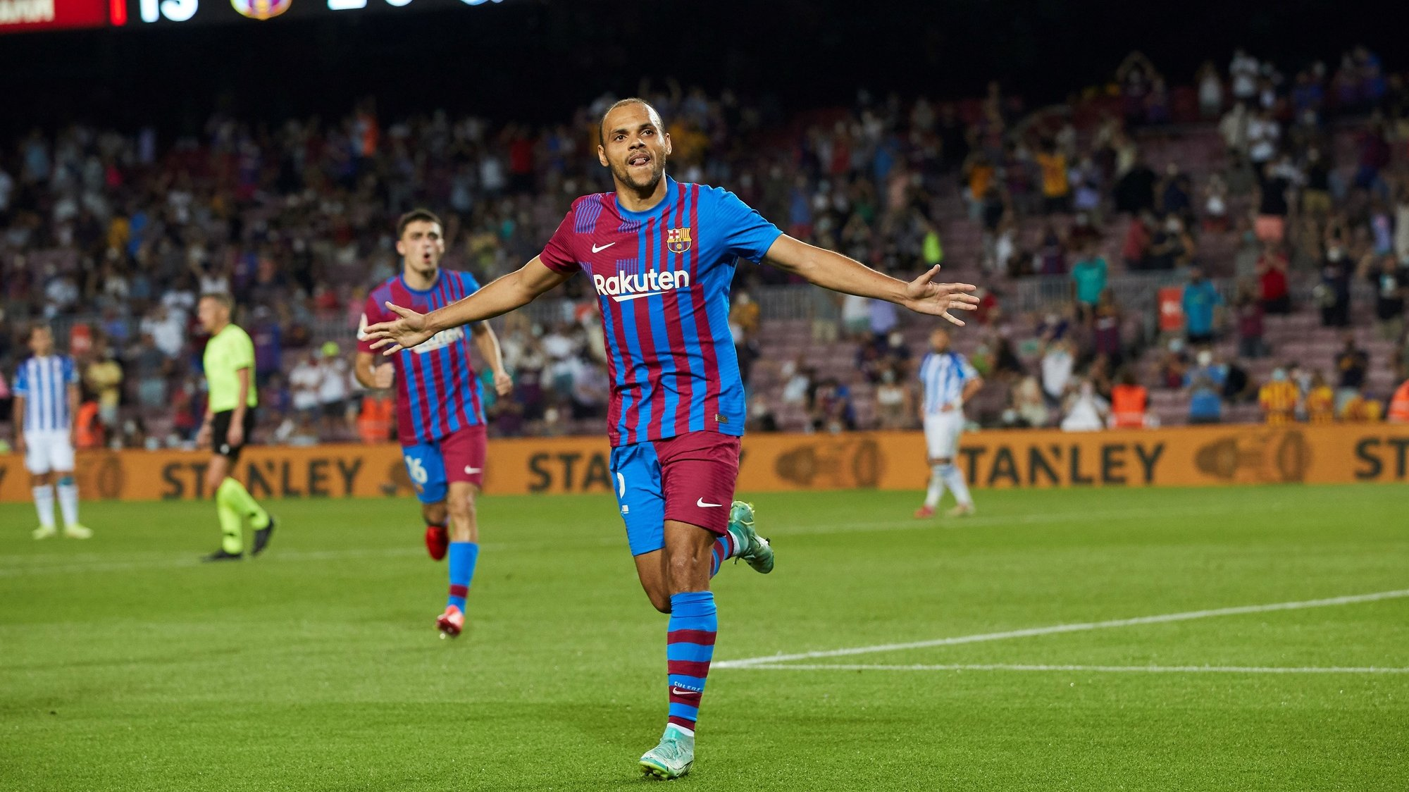 epa09415775 FC Barcelona's Martin Braithwaite celebrates after scoring the 3-0 lead during a Spanish LaLiga soccer match between FC Barcelona and Real Sociedad at Camp Nou in Barcelona, Spain, 15 August 2021.  EPA/Alejandro Garcia