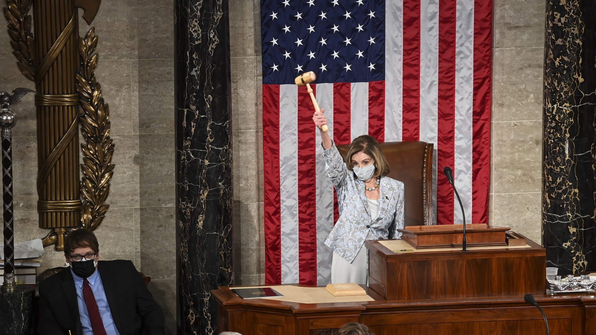 epa08917852 House Speaker Nancy Pelosi (D-Calif.) waves the gavel on the opening day of the 117th Congress at the US Capitol in Washington, DC, USA, 03 January 2021  EPA/Bill O'Leary / POOL