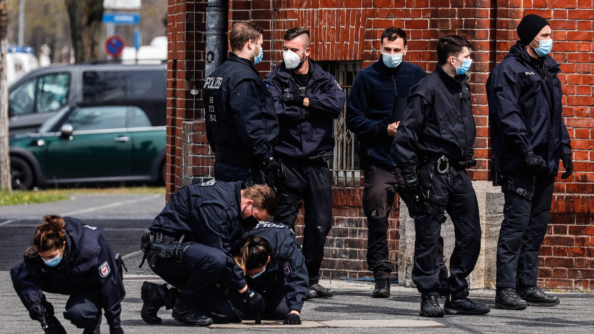 epa09167583 Police investigate in front of Oberlin care Clinic in Potsdam, Germany, 29 April 2021. German police arrested a woman on suspicion of killing four people on late evening of 28 April.  EPA/FILIP SINGER