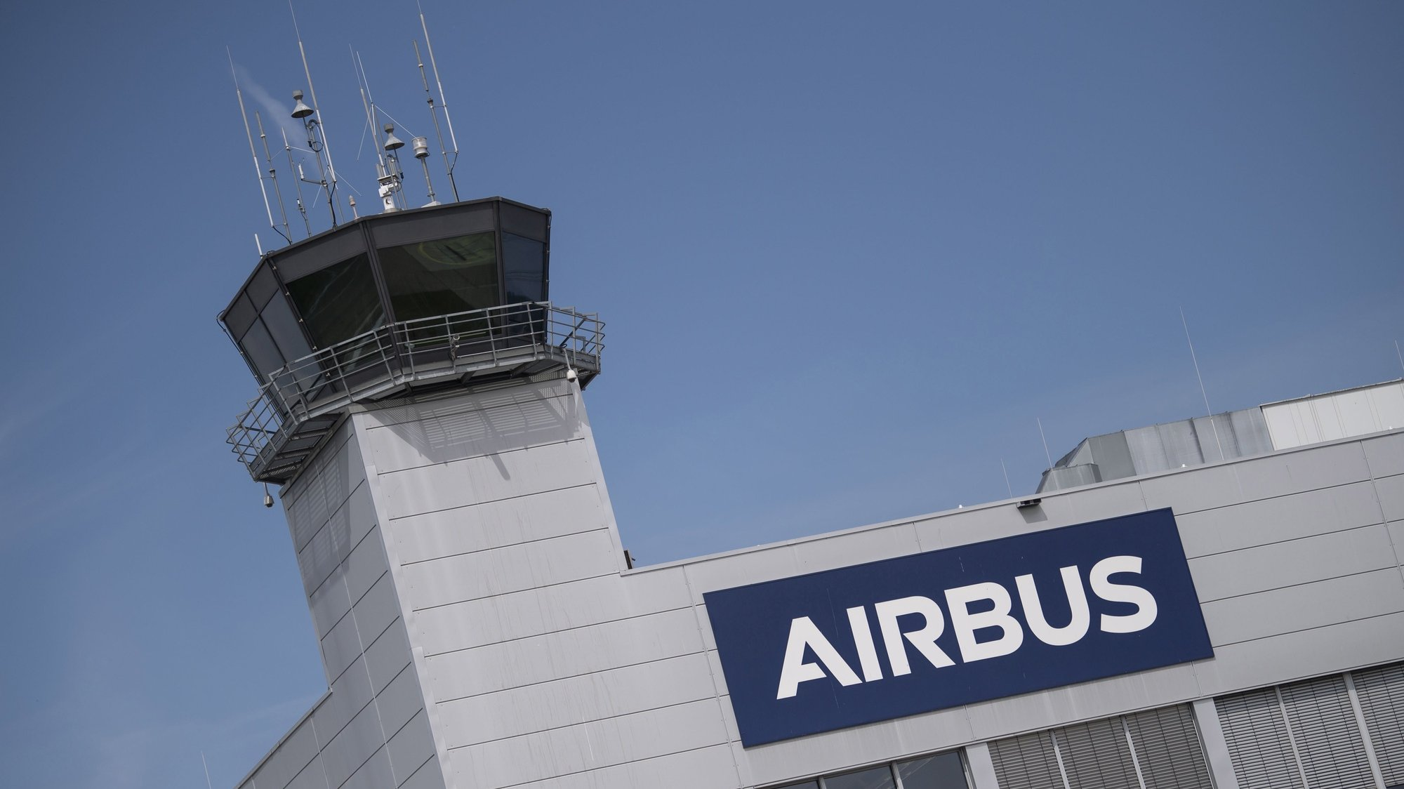 epa08574489 (FILE) - A Airbus logo at the apron of the German factory of Airbus Helicopters in Donauwoerth, Bavaria, Germany, 20 July 2020 (reissued 30 July 2020). Airbus on 30 July 2020 released their 2nd quarter 2020 results saying they suffered a 55 per cent drop in consolidated revenues for the 2nd quarter of 2020, with 8,317 million euro revenues in 2020 when compared with 2019 2nd quarter results of 18,317 million euro. Net profit for same period was in minus 1,438 million euro when compared with 1,157 million profit in 2019.  EPA/LUKAS BARTH-TUTTAS