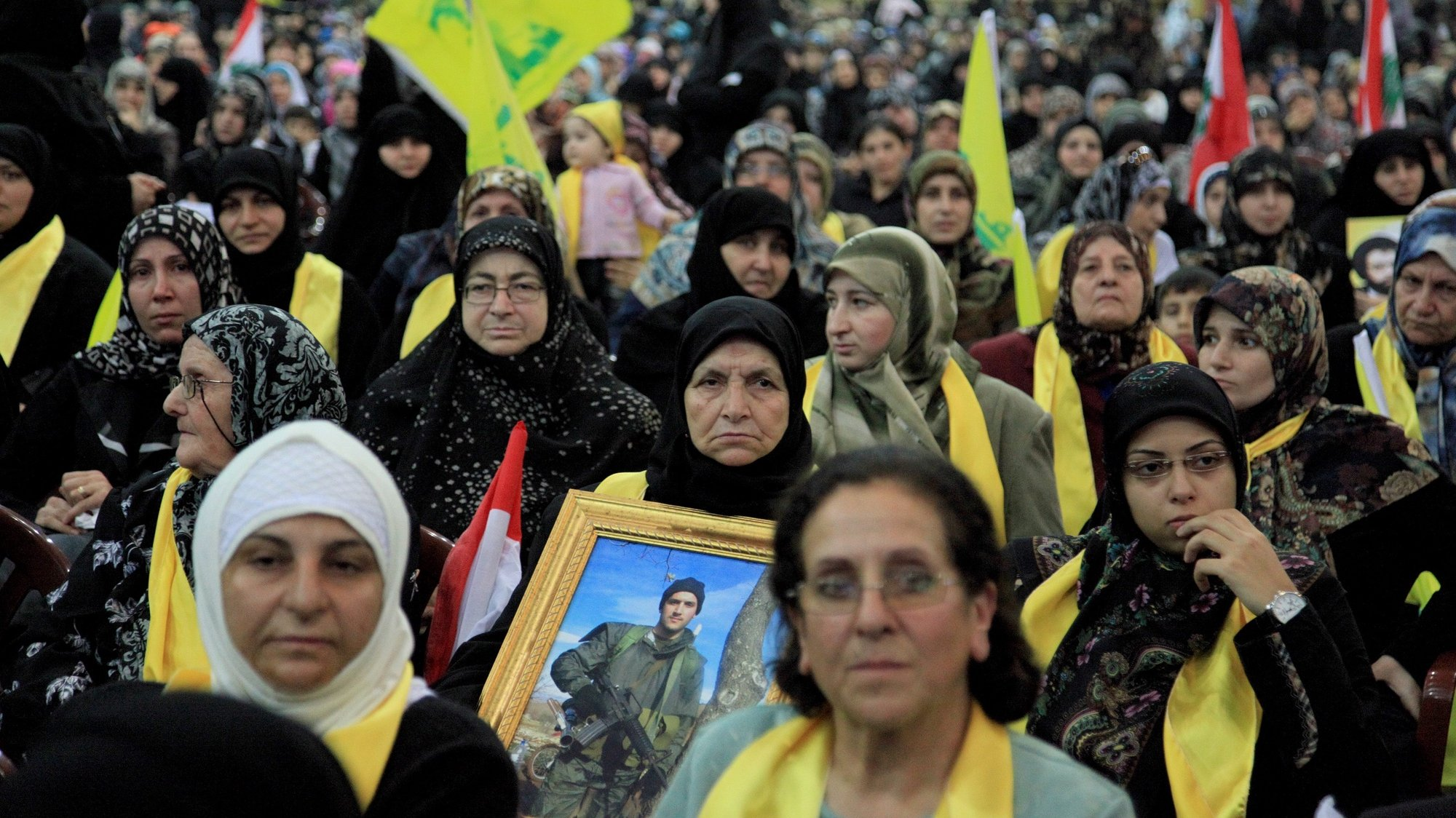 epa01929868 Relatives of Hezbollah fighters listen to Lebanese Shiite group leader Hassan Nasrallah (unseen) as he addresses a rally to commemorate Martyr's Day in the southern suburbs of Beirut, Libanon  11 November 2009. Hassan Nassrallah said during a speech: 'We call for cooperation and national solidarity government rather than a barricade government'.  Lebanon's incoming Prime Minister Saad Hariri announced on 09 November 2009 the new cabinet line-up after nearly five months of tough negotiations with his rivals in the Iran- and Syria-backed Hezbollah-led alliance.  EPA/NABIL MOUNZER