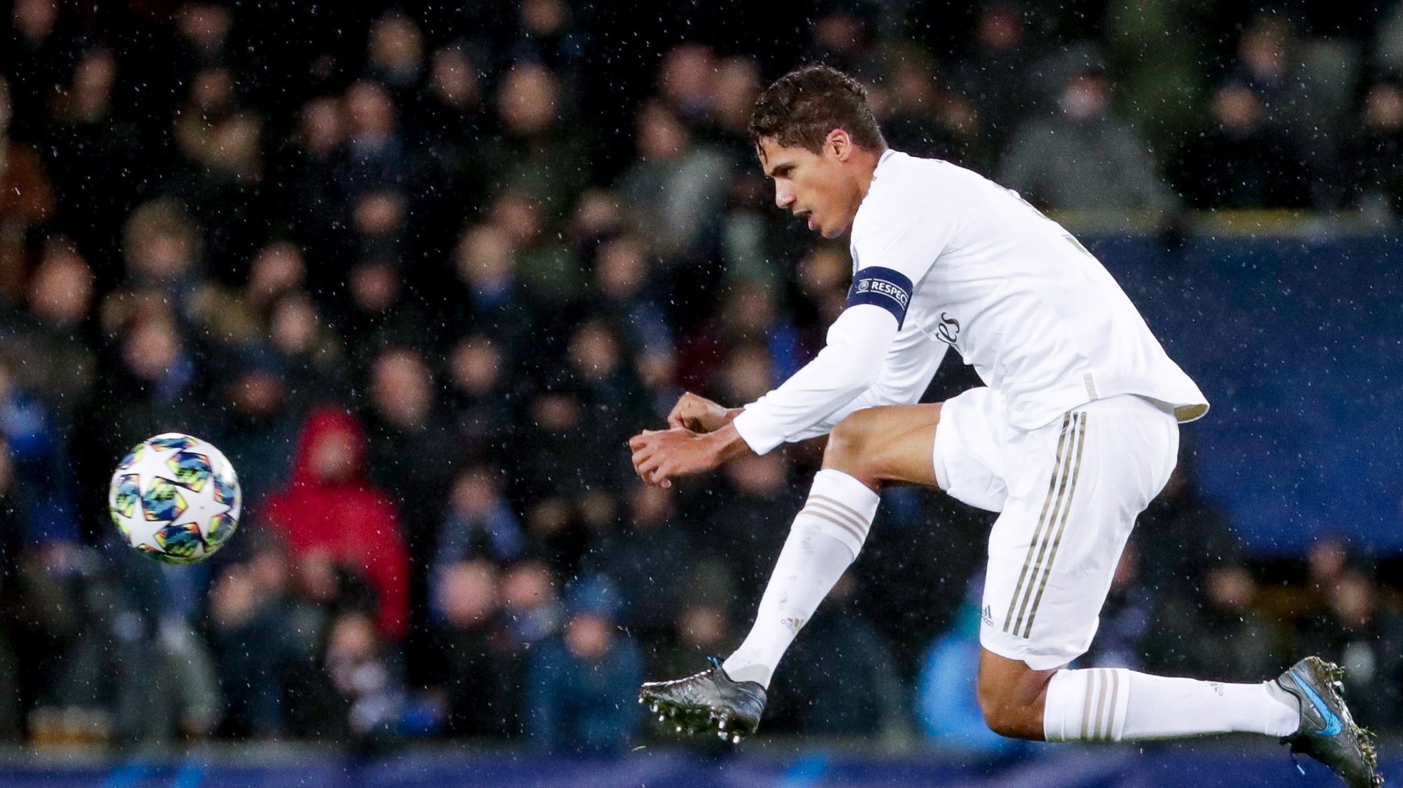 epa08063776 Raphael Varane of Real Madrid in action during the UEFA Champions League group A match between Club Brugge and Real Madrid in Bruges, Belgium, 11 December 2019.  EPA/STEPHANIE LECOCQ