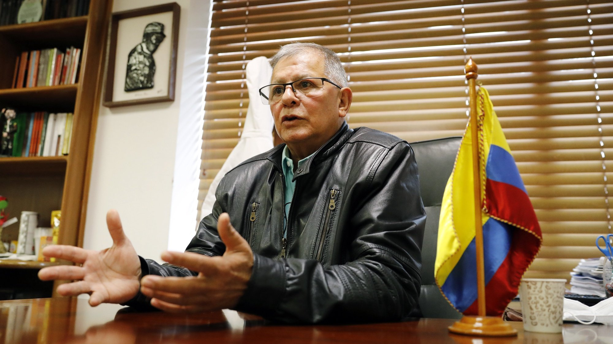 epa08836075 Former guerrilla chief Rodrigo Granda speaks with Efe during an interview in Bogota, Colombia, 19 November 2020 (issued 22 November). The murder of former FARC guerrillas, which has claimed the lives of 243 of them, and the legal insecurity for those who laid down their arms are the main shadows that loom over the Colombian peace agreement signed four years ago, says the former chief guerrilla Rodrigo Granda. 'A vital point for us, such as (that of) security guarantees, does not exist. At this time we already have 243 assassinated from the new political movement,' Granda said.  EPA/Mauricio Duenas Castaneda