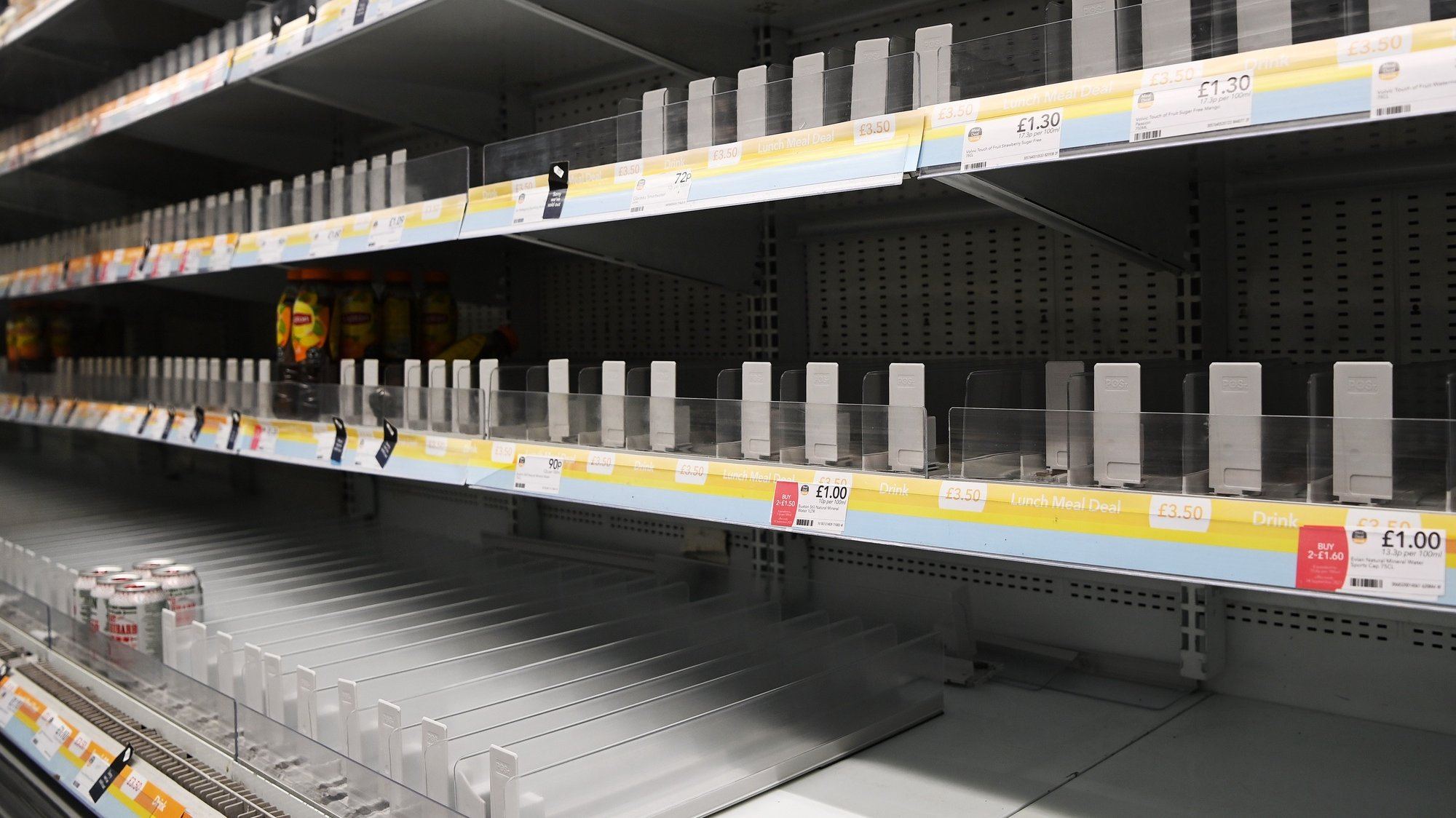 epa09430566 Bare shelves at a supermarket in central London, Britain, 26 August 2021. The shortage of lorry drivers has left supermarkets and restaurants short of produce across the UK. Nando's and McDonald's has been hit by supply chains in recent days. Brexit and the Covid pandemic has meant there aren't enough lorry drivers to meet the demand.  EPA/ANDY RAIN