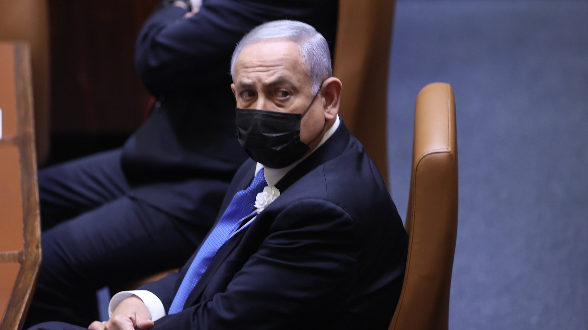epa09118693 Israeli Prime Minister Benjamin Netanyahu attends the swearing in ceremony of the Israeli 24th Israeli Knesset (parliament) in Jerusalem, Israel, 06 April 2021. Israeli President Reuven Rivlin announced earlier that as a result of his consultations no candidate has a realistic chance of forming a government, but nominated Prime Minister and leader of Likud MK Benjamin Netanyahu with forming a government.  EPA/Alex Kolomoisky / POOL
