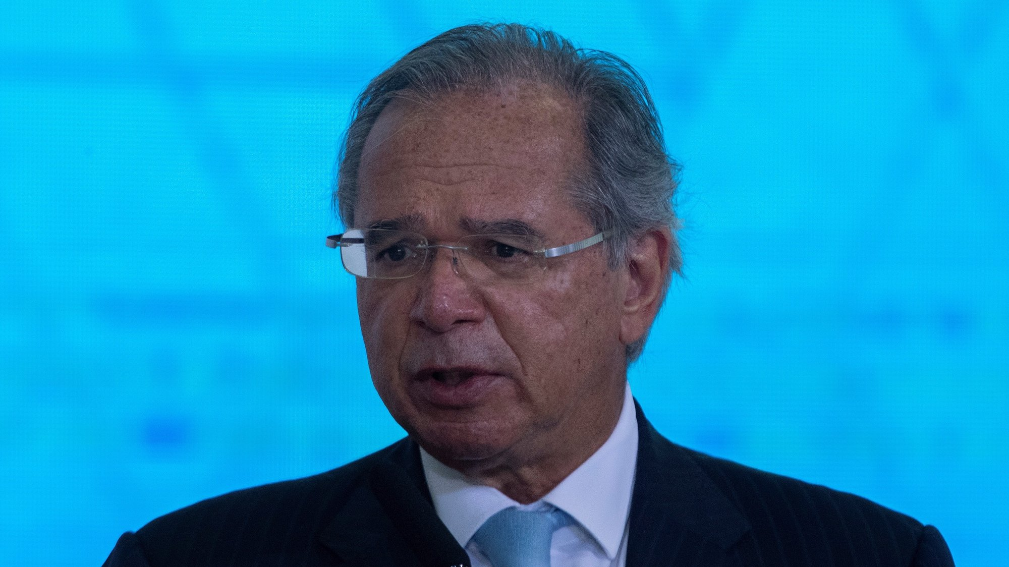 epa09343161 The Brazilian Minister of Economy, Paulo Guedes, speaks during the sanction ceremony of the Eletrobras Capitalization Law, at the Planalto Palace in Brasilia, Brazil, 13 July 2021. Bolsonaro sanctioned with some vetoes the Provisional Measure that regulates the privatization process of the state giant Eletrobras, the largest electricity company in Latin America, according to the Official Gazette of the Union published on 13 July.  EPA/Joedson Alves
