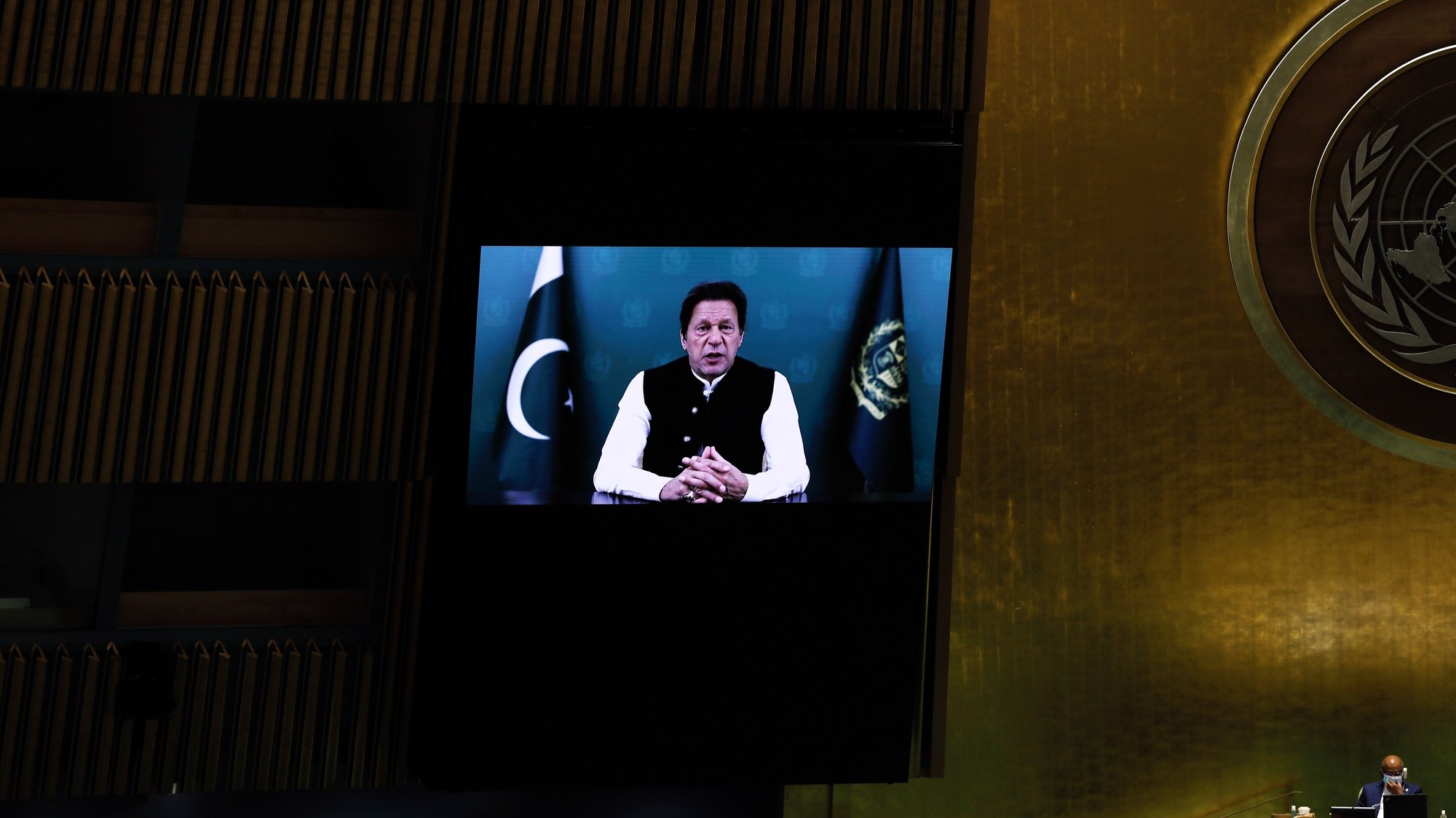epa09486571 Prime Minister of Pakistan, Imran Khan addresses, via prerecorded video the General Debate of the 76th Session of the United Nations General Assembly at UN Headquarters in New York, New York, USA, 24 September 2021.  EPA/PETER FOLEY