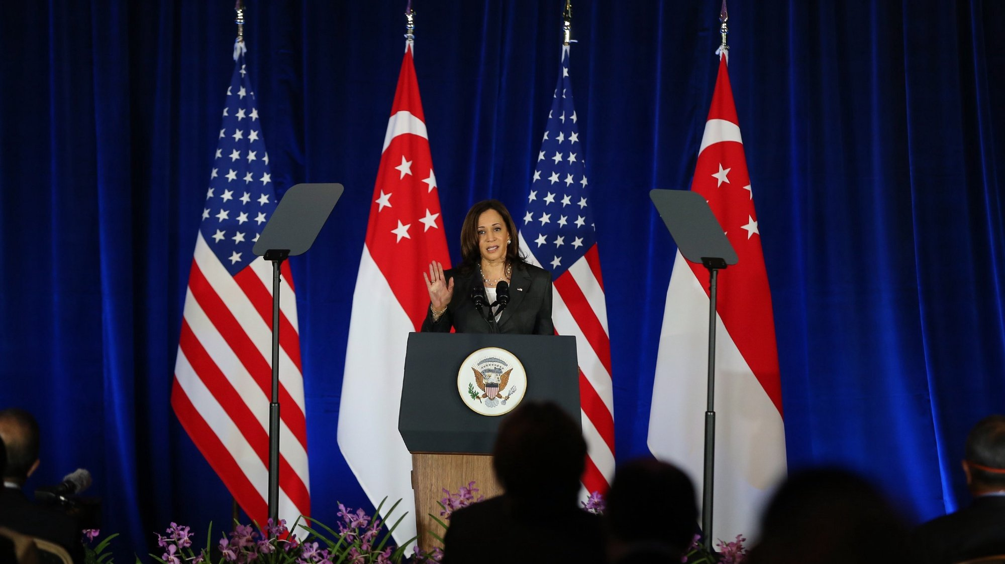 epa09427015 US Vice President Kamala Harris delivers a speech at Gardens by the Bay in Singapore, 24 August 2021. US Vice President Kamala Harris is on an official three-day visit to Singapore before heading to Vietnam on 24 August 2021.  EPA/ONG WEE JIN / SPH SINGAPORE OUT