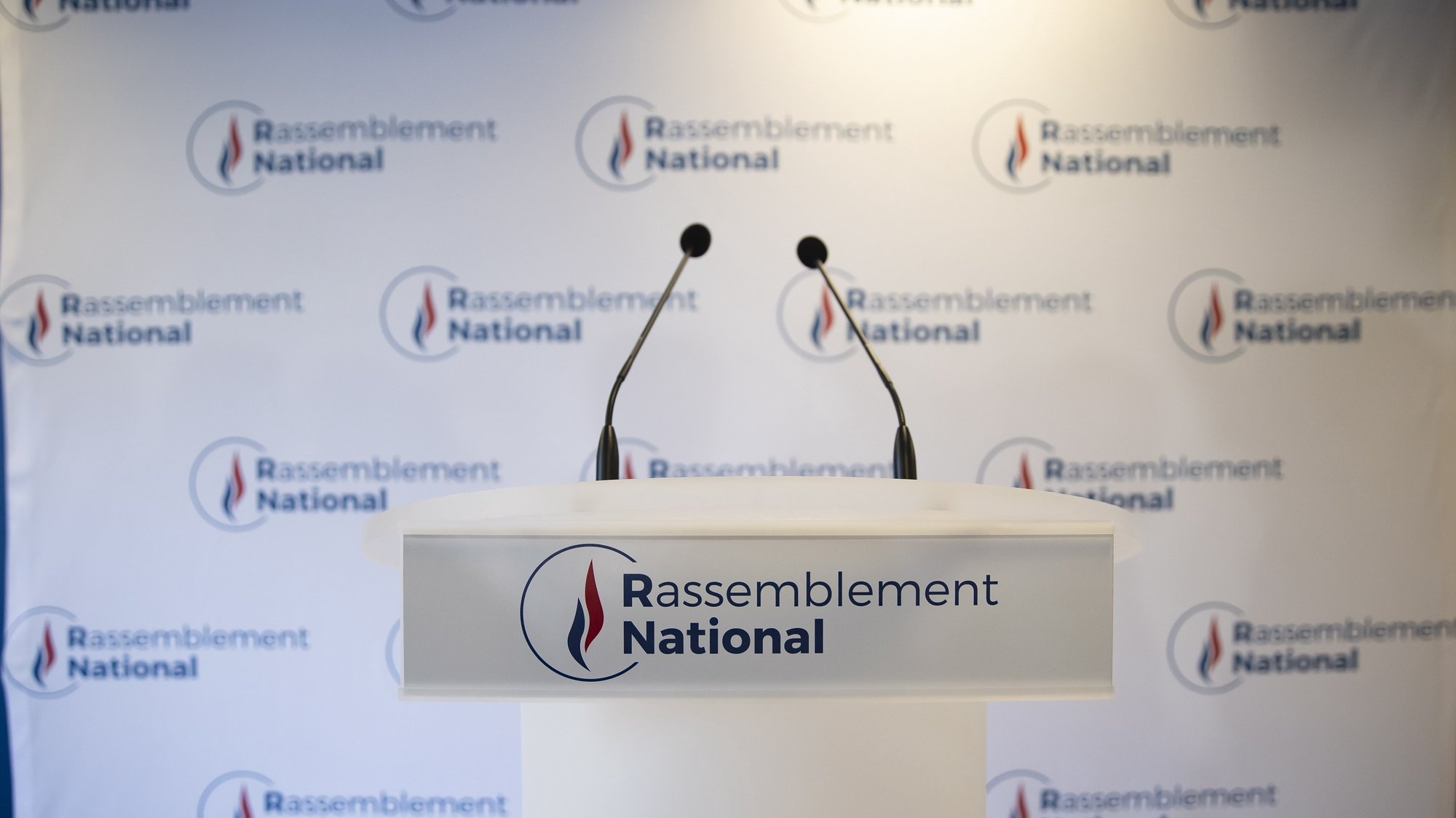 epa09306535 A view of an empty podium ahead of far-right Rassemblement National (RN) party's president Marine Le Pen's statement at the party headquarters in Nanterrre near Paris, France, 27 June 2021. Polls closed after a second round vote of the country's regional election, with early estimations indicating a clear loss for France's RN party.  EPA/IAN LANGSDON