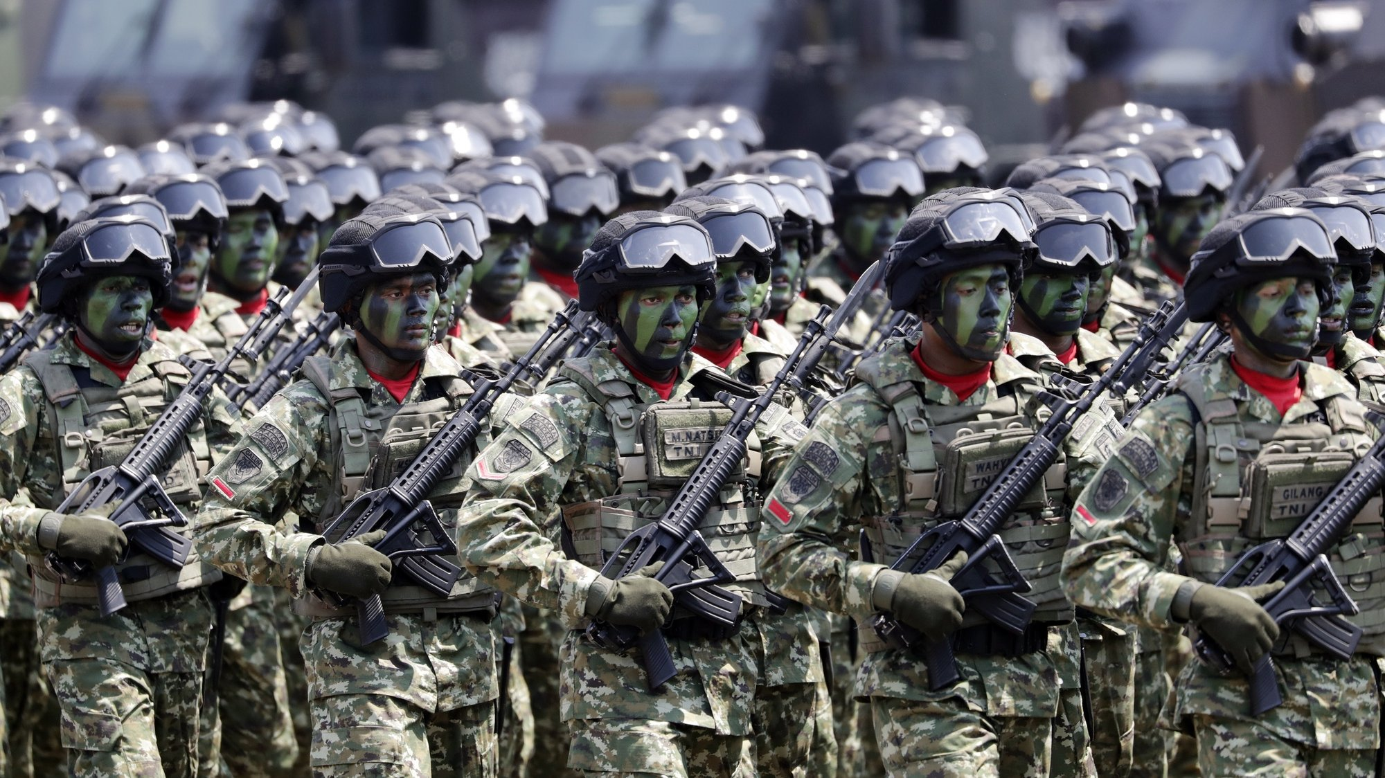 epa07897179 Indonesian Army soldiers march during a ceremony to mark the 74th Indonesian National Armed Forces Day, at Halim Perdanakusuma Air Force Base in Jakarta, Indonesia, 05 October 2019.  EPA/MAST IRHAM