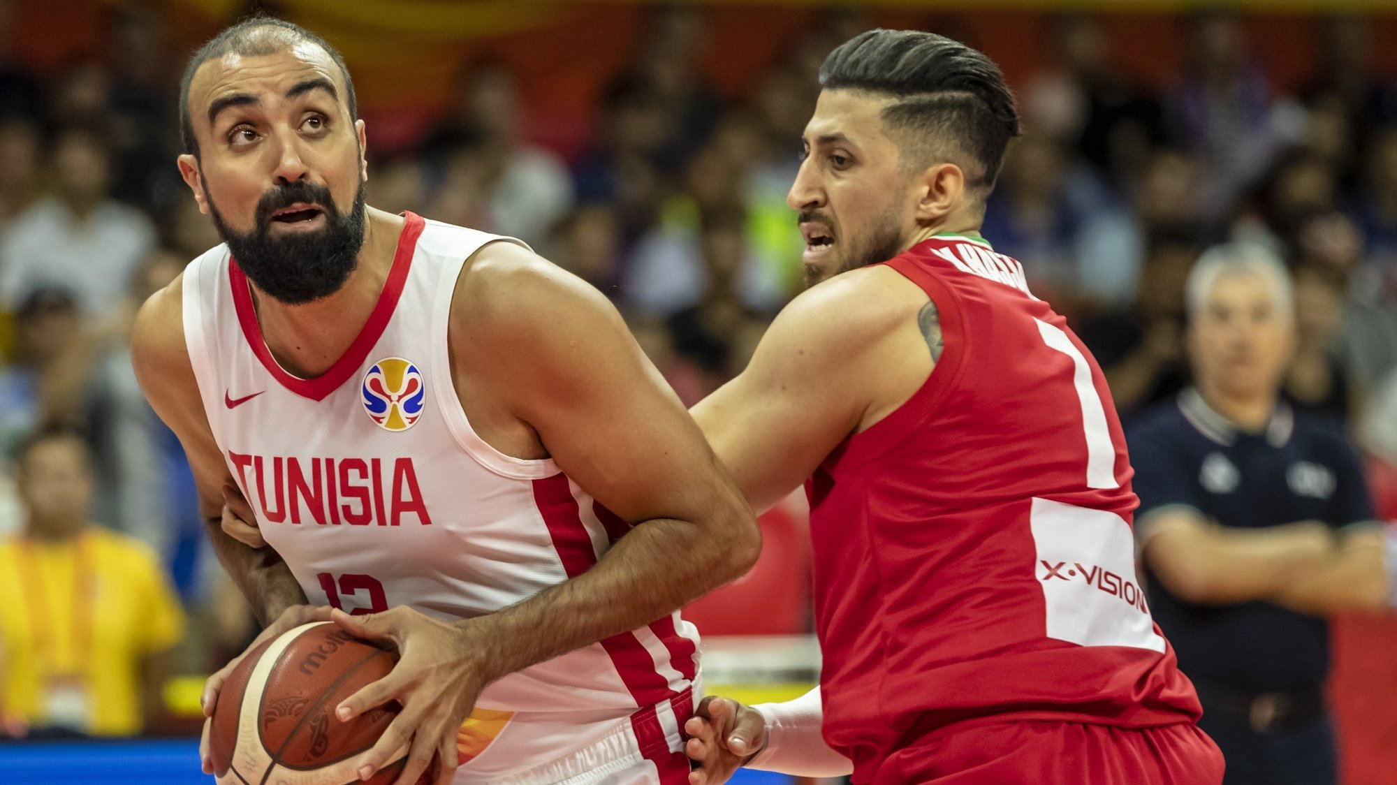 epa07812130 Makram Ben Romdhane of Tunisia (L) in action against Mohammad Hassanzadeh of Iran (R) during the FIBA Basketball World Cup 2019 match between Tunisia and Iran in Guangzhou, China, 02 September 2019.  EPA/ALEX PLAVEVSKI