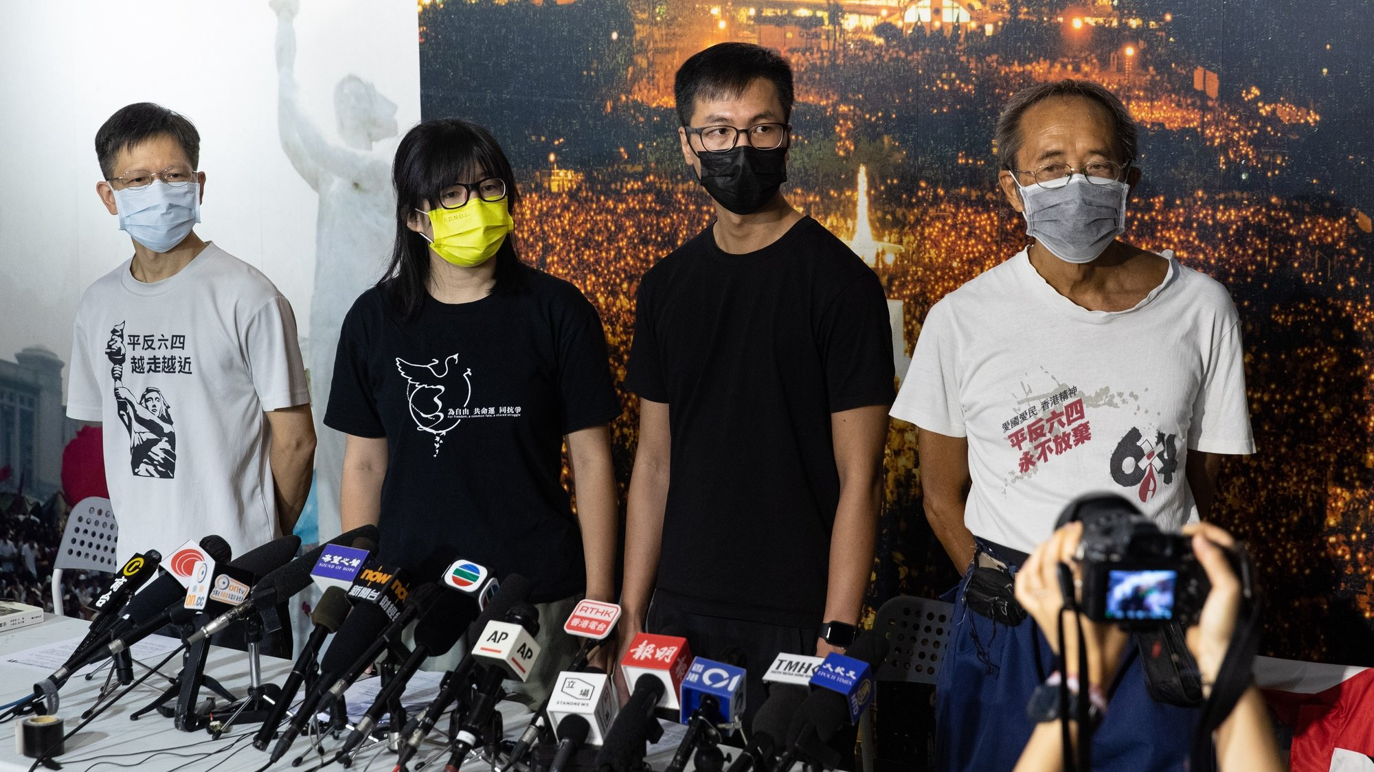 epa09454469 The vice-chairwoman of The Hong Kong Alliance in Support of Patriotic Democratic Movements in China Chow Hang-tung (2-L) and fellow alliance members Leung Kam-wai (2-R), and Tang Ngok-kwan (L), meet reporters in Hong Kong, China, 05 September 2021, (issued 08 September 2021). Chow, Leung, Tang and another core member of the alliance organizing Hong Kong's annual Tiananmen Square candlelit vigil were arrested early 08 September 2021, one day after officially refusing to cooperate with a national security investigation.  EPA/JEROME FAVRE