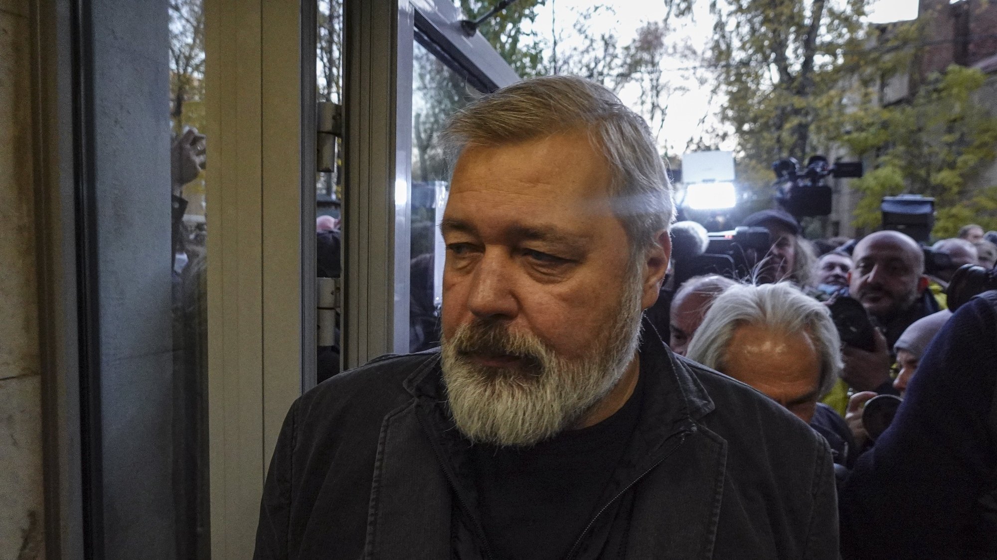 epa09513449 The 2021 Nobel Peace Prize laureate, the editor-in-chief of 'Novaya Gazeta' newspaper Dmitry Muratov enters the head office of the 'Novaya Gazeta' in Moscow, Russia, 08 October 2021. Muratov along with Maria Ressa, CEO and Executive Editor of online news site Rappler, were announced winners of the 2021 Nobel Peace Prize by the Nobel Committee in Oslo on 08 October 2021.  EPA/MAXIM SHIPENKOV