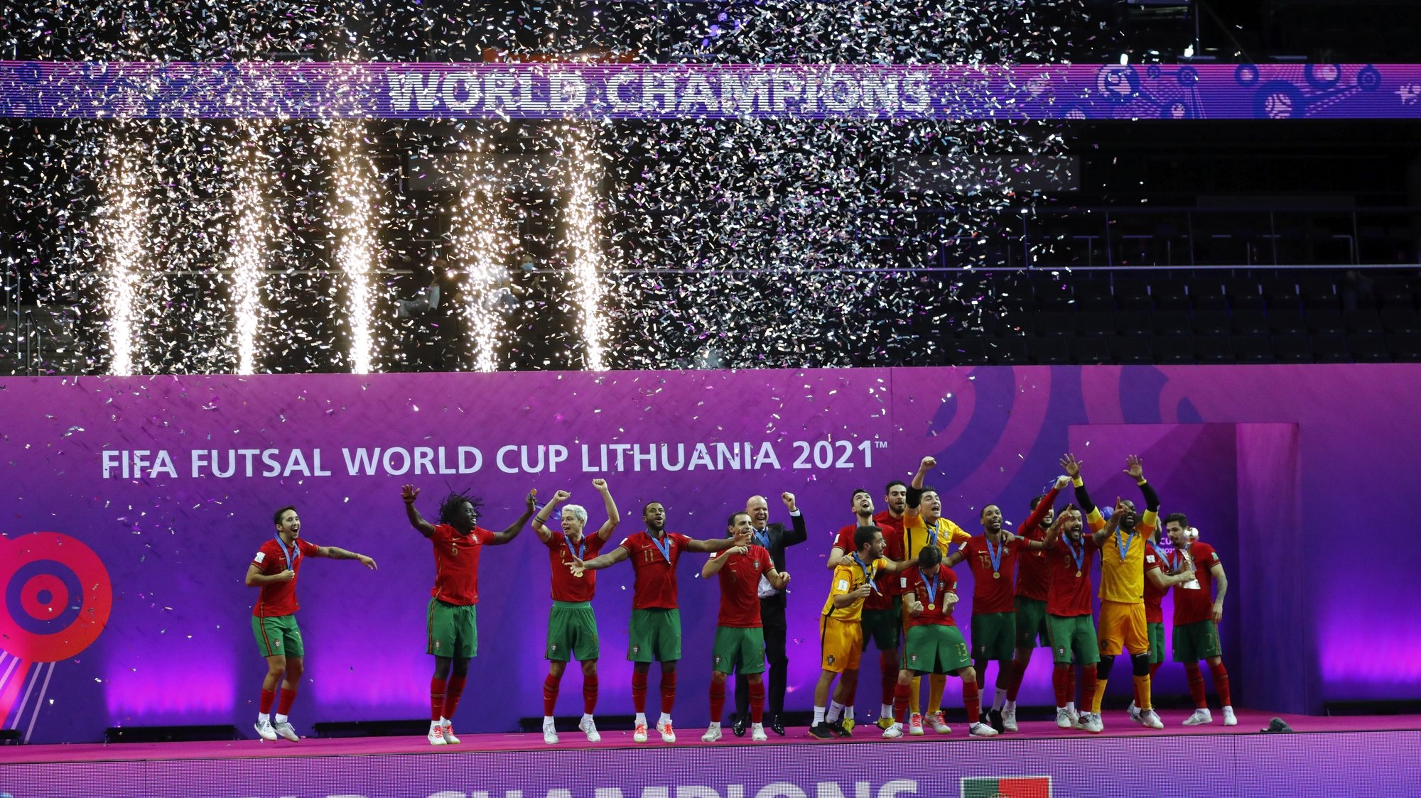 epa09504591 Players of Portugal celebrate during the award ceremony after winning the FIFA Futsal World Cup Lithuania 2021 final between Argentina and Portugal in Kaunas, Lithuania, 03 October 2021.  EPA/TOMS KALNINS