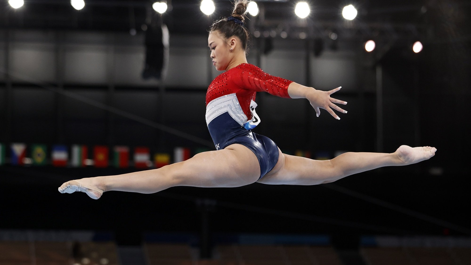 epaselect epa09370482 Sunisa Lee of the USA performs on the Balance Beam during the Women's Team final during the Artistic Gymnastics events of the Tokyo 2020 Olympic Games at the Ariake Gymnastics Centre in Tokyo, Japan, 27 July 2021.  EPA/HOW HWEE YOUNG