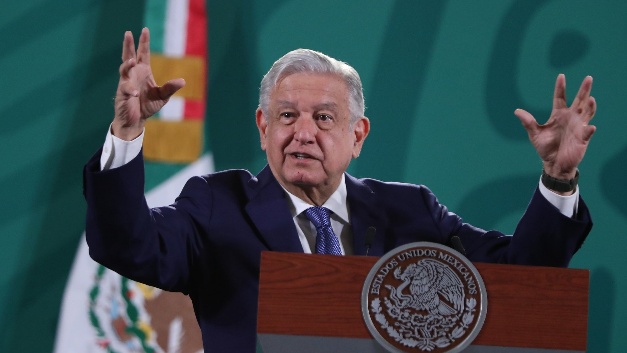 epa09437010 President of Mexico Andres Manuel Lopez Obrador during a morning press conference at the National Palace, in Mexico City, Mexico, 30 August 2021. The generalized return to face-to-face classes started on 30 August in Mexico after a year and a half of schools closed due to the coronavirus pandemic and due to the fear of some families due to the third wave of covid-19 infections that the country has suffered for weeks.  EPA/MARIO GUZMAN