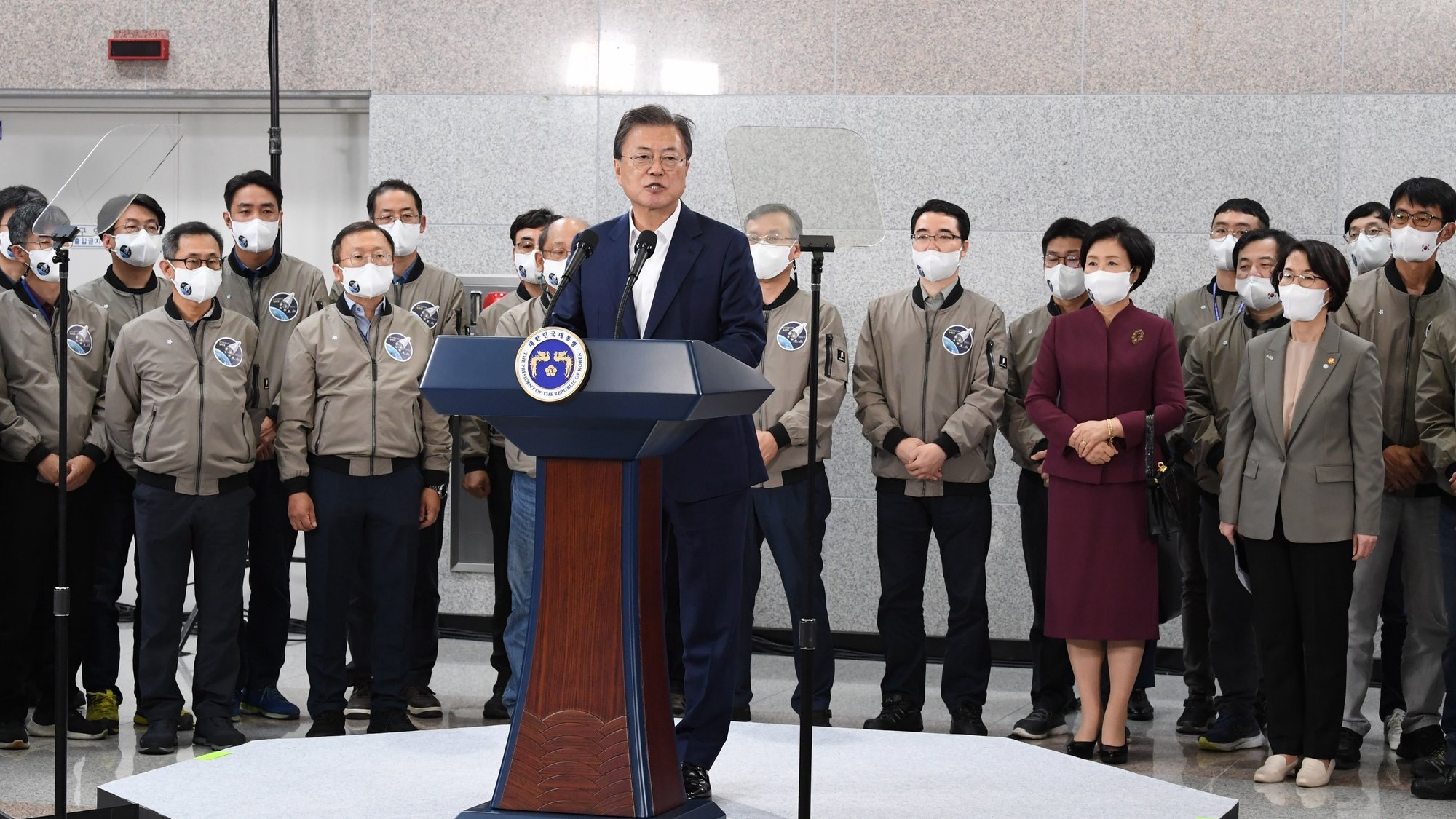 epa09535633 South Korean President Moon Jae-in delivers a public message after the country's first homegrown space launch vehicle, known as Nuri, lifted off from the Naro Space Center in Goheung, South Korea, 21 October 2021.  EPA/YONHAP SOUTH KOREA OUT