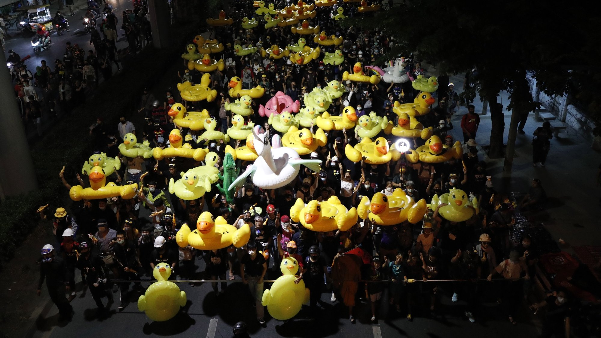 epaselect epa08850460 Anti-government protesters march with inflatable rubber ducks during a street protest calling for a political and monarchy reform at the 11th Infantry Regiment, the headquarters of the King's Guard regiment in Bangkok, Thailand, 29 November 2020. Thailand's politics intensified by months-long street protests calling for the political and monarchy reform and the resignation of the prime minister.  EPA/RUNGROJ YONGRIT