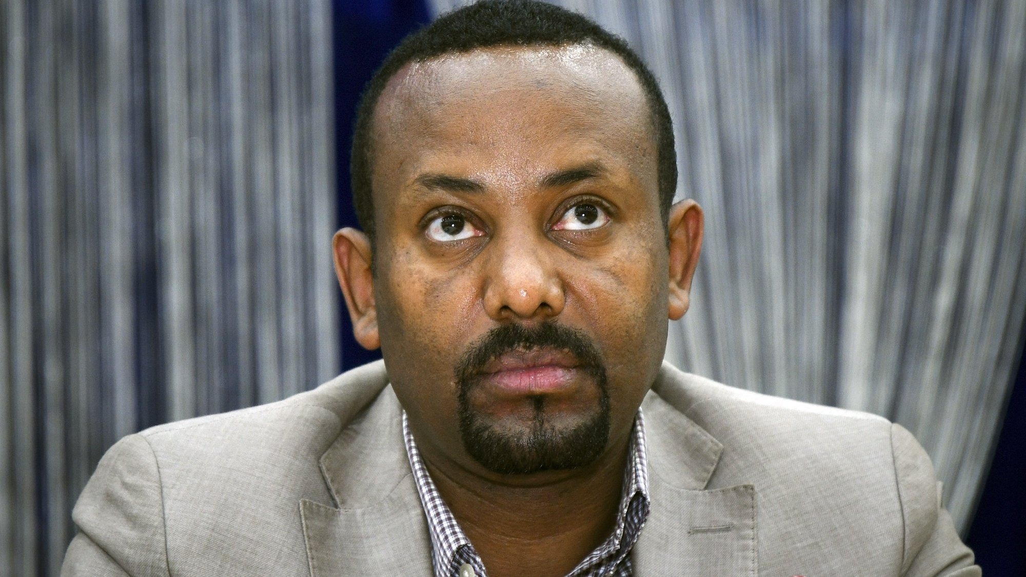 epa08842824 (FILE) - The then leader of the 'Oromo Peoples Democratic Organization' (OPDO), now Prime Minister Abiy Ahmed looks on during a news conference in Aba Geda, Ethiopia, 02 November 2017 (reissued 26 November 2020). Ethiopia's prime minister announced on 26 November that the army has been ordered to move on the Tigray regional capital after the end of a 72-hour ultimatum to the region's leaders to surrender.  EPA/STR