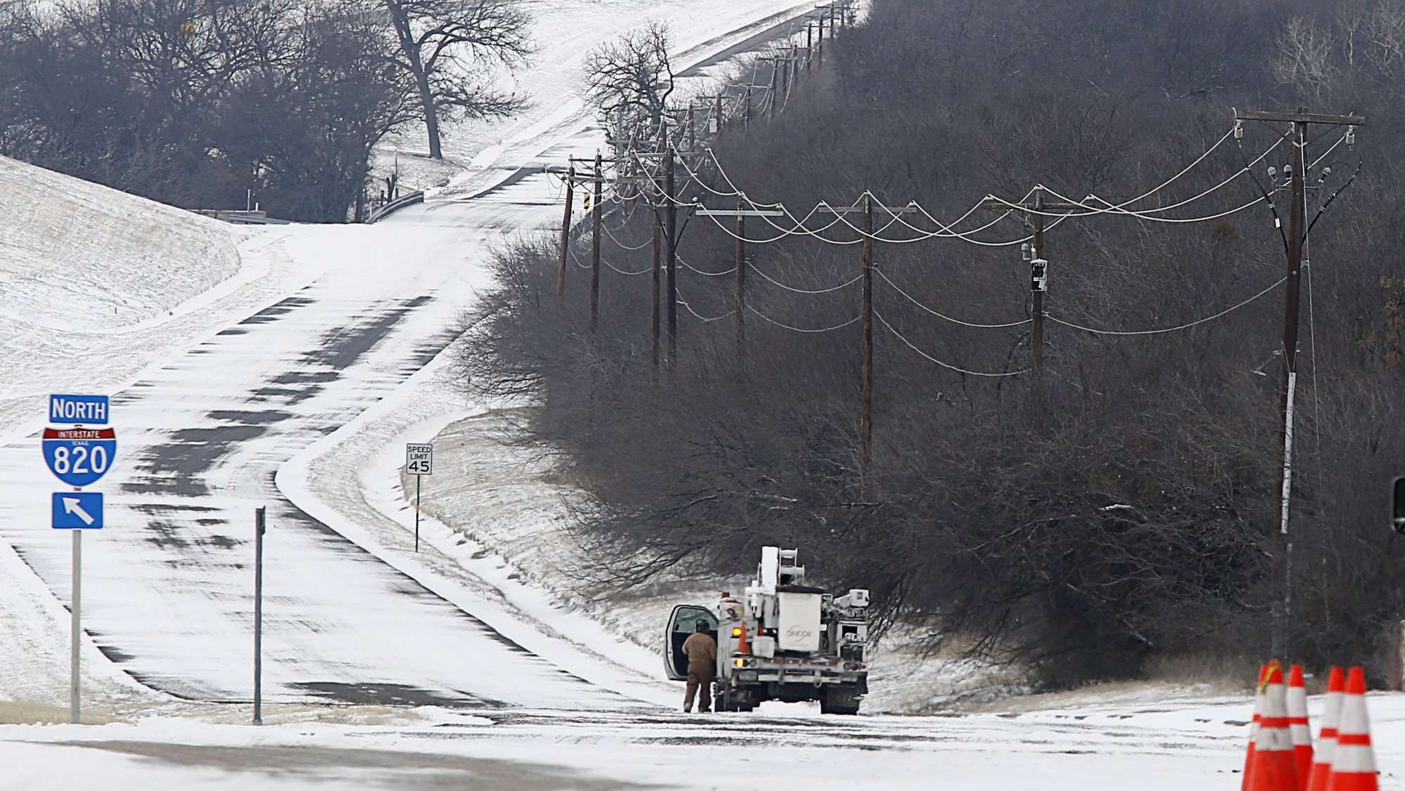 epa09020166 An Oncor Power truck and crew work along Loop 820 in Fort Worth, Texas, 17 February 2021. The electric grid in Texas run by the non profit Ercot, has been overwhelmed by high demand leaving millions without power in the state. Snow and cold weather have blanket North Texas for the fourth day in unseasonably cold weather, with overnight temperatures dropping to -10 degrees celsius in Fort Worth.  EPA/Ralph Lauer