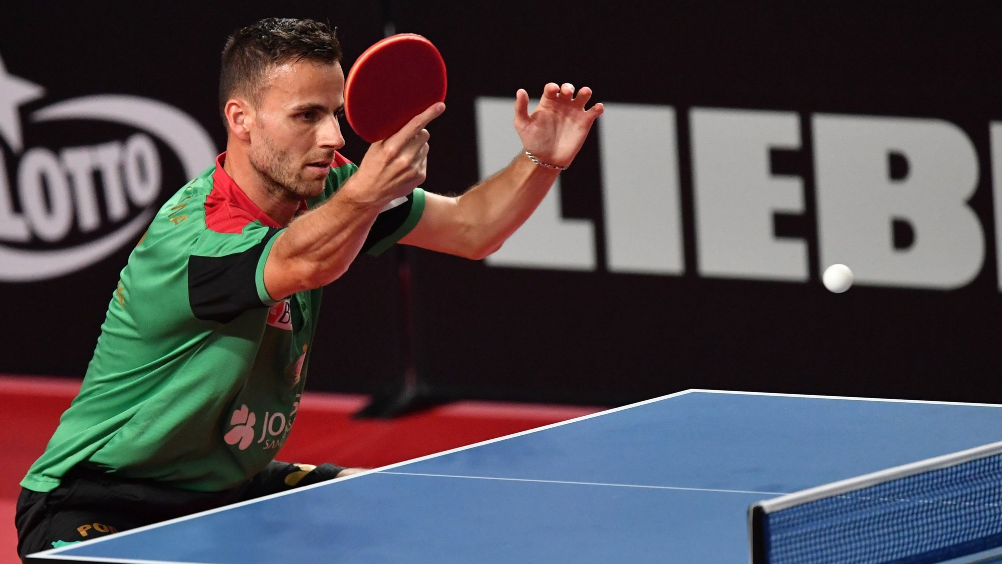 epa09301850 Tiago Apolonia of Portugal in action against Jon Persson of Sweden in the men's singles qualifiers during the ITTF European Table Tennis Championships 2020 in Warsaw, Poland, 25 June 2021.  EPA/Piotr Nowak POLAND OUT