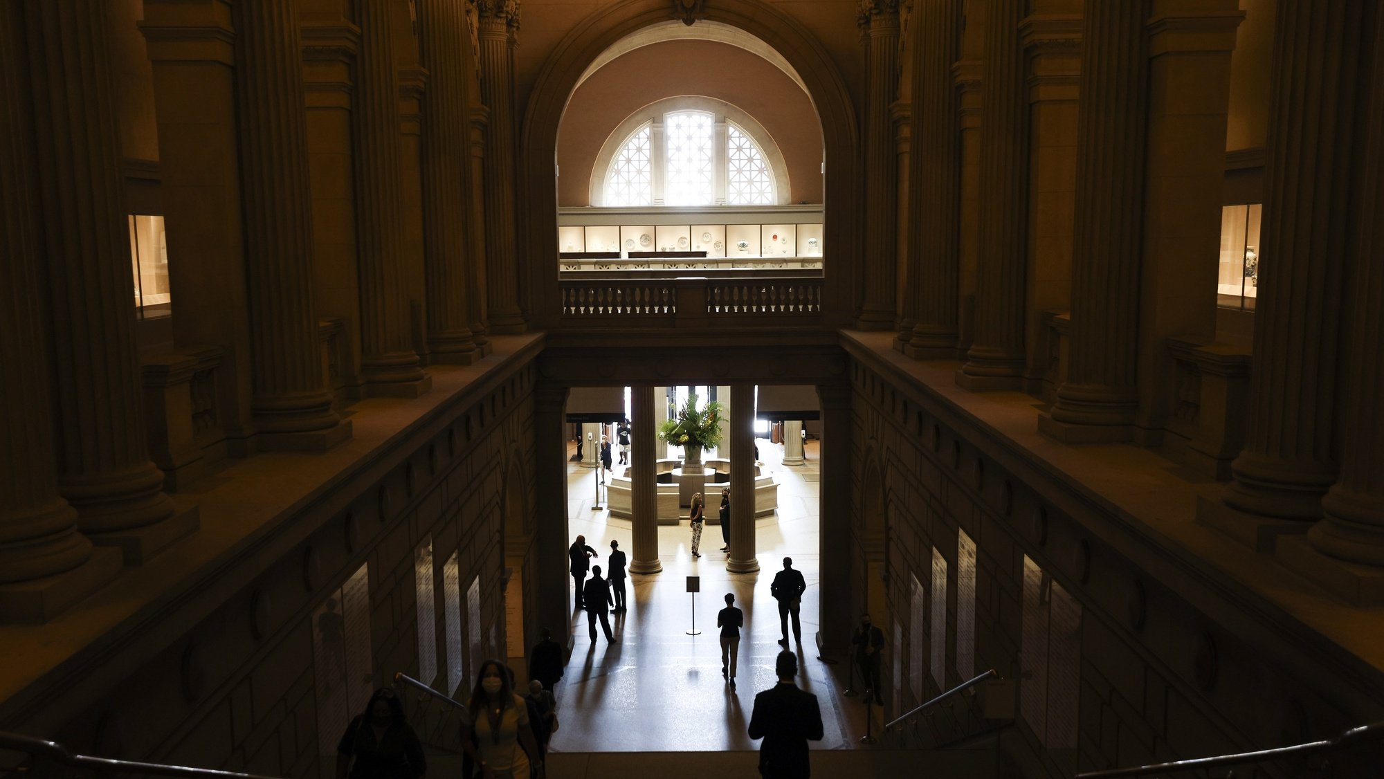 epa08630139 People are seen in the main entry of the Metropolitan Museum of Art on the first day that the museum is reopening to the public in New York, New York, USA, 27 August 2020.  The Met, along with other museums in the city, has been closed since March 2020 as a result of the coronavirus pandemic and is now reopening at 25 percent capacity.  EPA/JUSTIN LANE