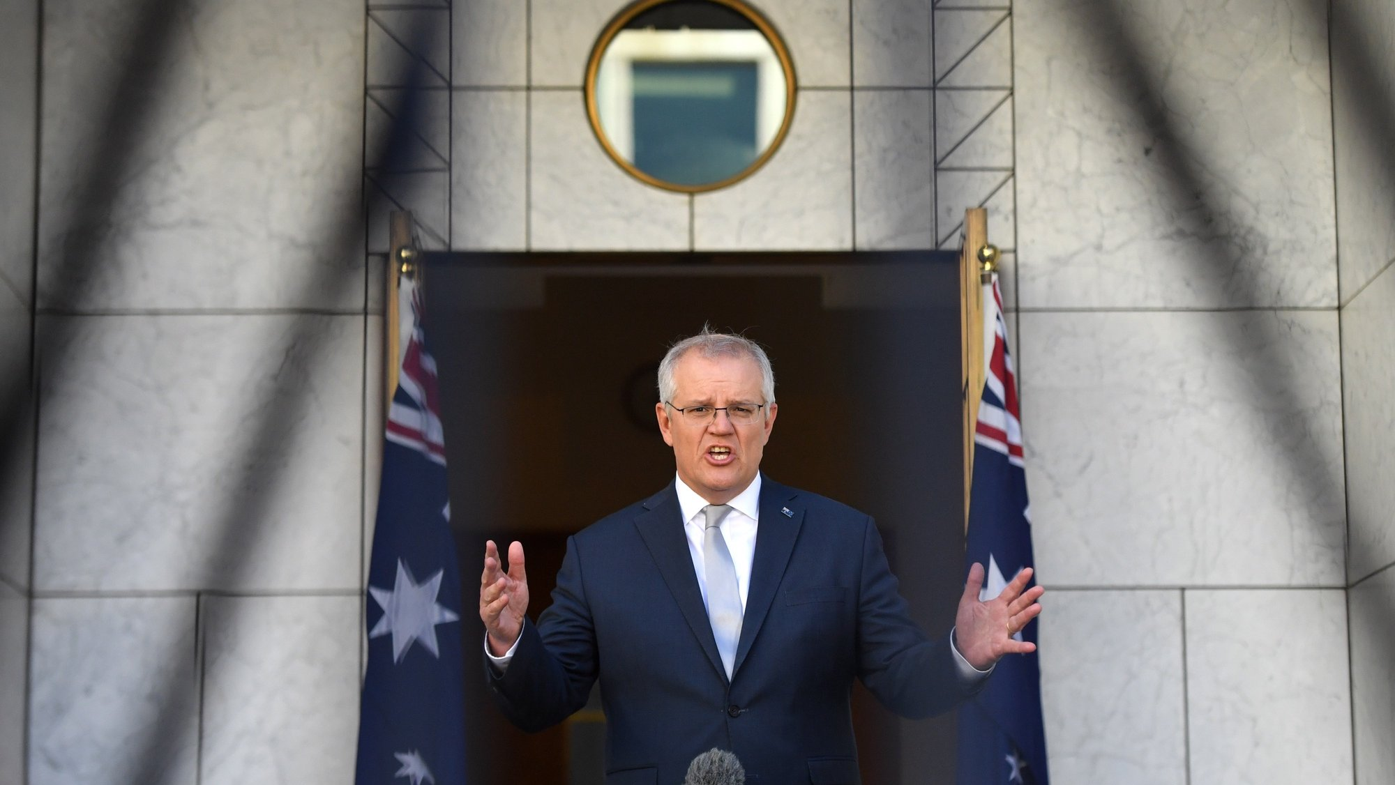 epaselect epa09535399 Australian Prime Minister Scott Morrison speaks during a morning television interview in his courtyard at Parliament House in Canberra, Australian Capital Territory, Australia, 21 October 2021.  EPA/MICK TSIKAS AUSTRALIA AND NEW ZEALAND OUT