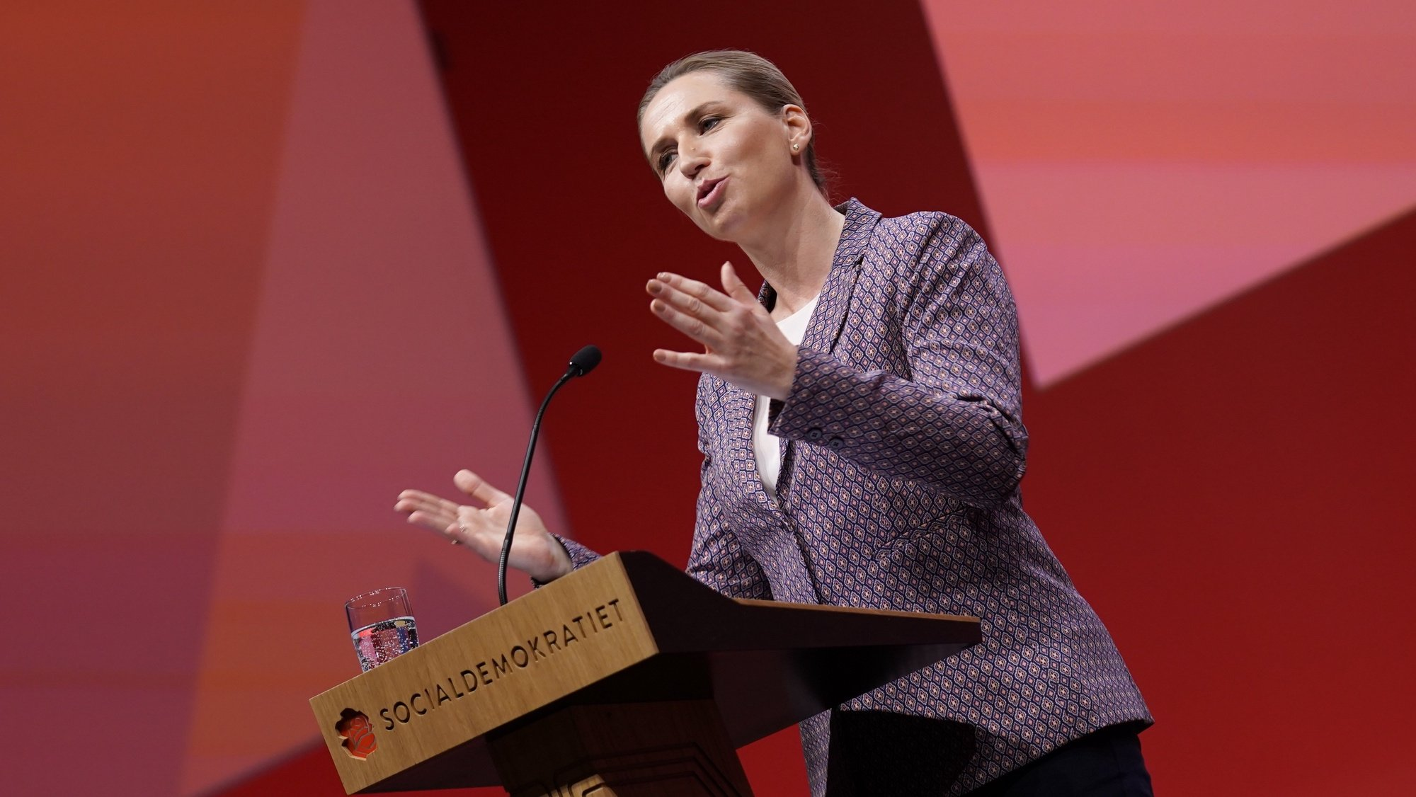 epa09474482 Denmark's Prime Minister and head of the Social Democrats Mette Frederiksen delivers her opening speech at the Social Democrats Congress in Aalborg, Denmark, 18 September 2021.  EPA/Henning Bagger  DENMARK OUT