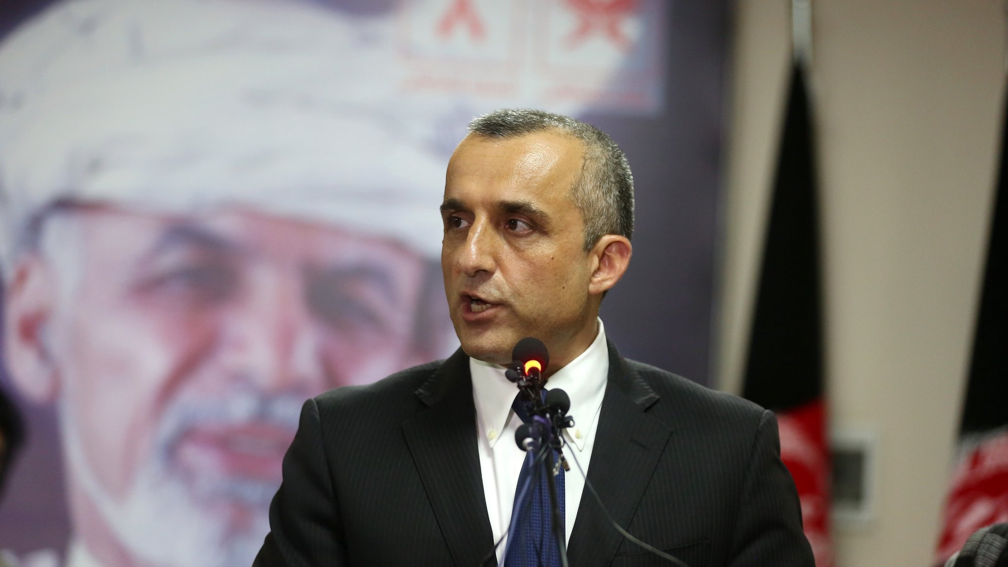 epa07882828 Afghanistan presidential candidate Ashraf Ghani's First Vice President Amrullah Saleh from the State Building electoral team briefs journalists about the outcomes of the presidential election during a press conference in Kabul, Afghanistan, 30 September 2019.  EPA/JAWAD JALALI