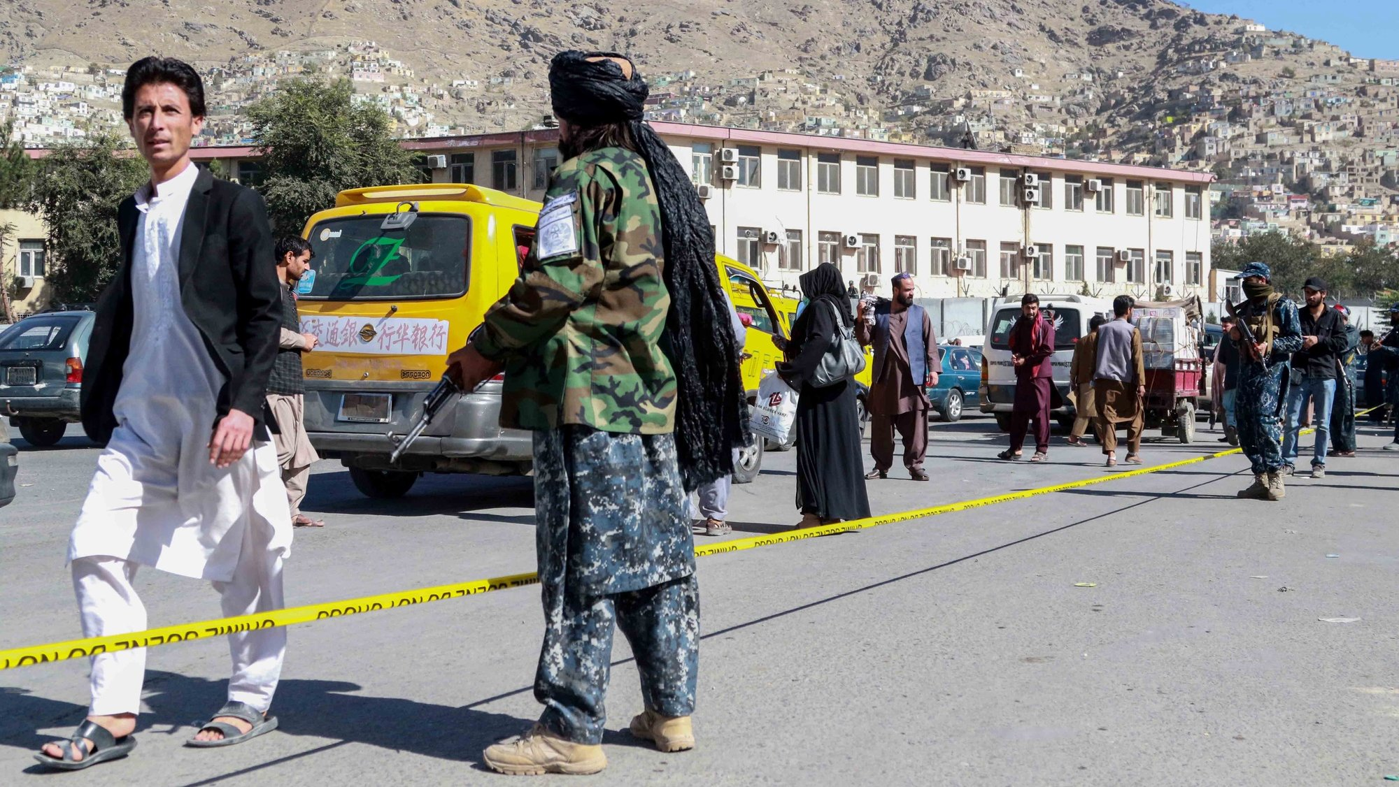 epa09534068 Taliban stand guard at the scene of a bomb blast in Kabul, Afghanistan, 20 October 2021. At least two people were killed according to the Afghan Interior Ministry in a blast that earlier rocked the Deh Mazang district in Kabul.  EPA/STRINGER