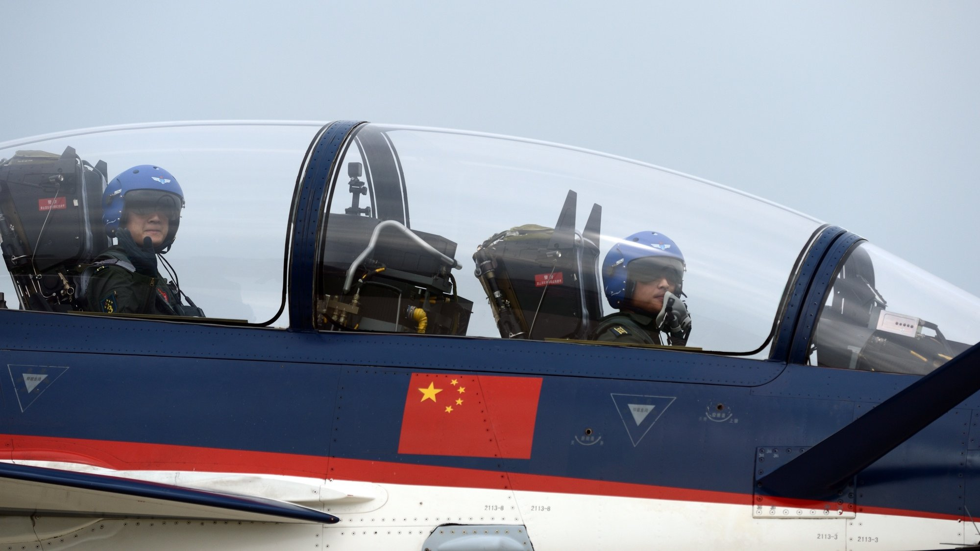 epa06998541 Members of the August 1st Aerobatic Team drive J-10 fighter jet to perform at Aviation University of Air Force during an aviation open day of the Air Force in Changchun, China's Jilin province, 02 September 2018 (issued 05 September 2018). The aviation open day of the Air Force of the CPLA and the opening ceremony for the Aviation University of Air Force (AUAF) was held at the Dafangshen Airport in Changchun from 30 August to 02 September 2018.  EPA/STRINGER CHINA OUT