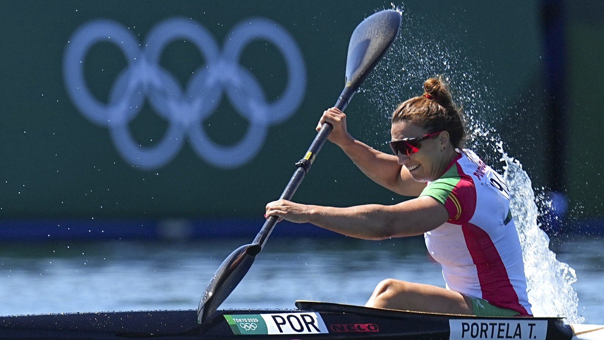 epa09396143 Teresa Portela from Portugal in action during the Women's Kayak Single 500m Semifinals of the Canoeing Sprint events of the Tokyo 2020 Olympic Games at the Sea Forest Waterway in Tokyo, Japan, 05 August 2021.  EPA/NIC BOTHMA